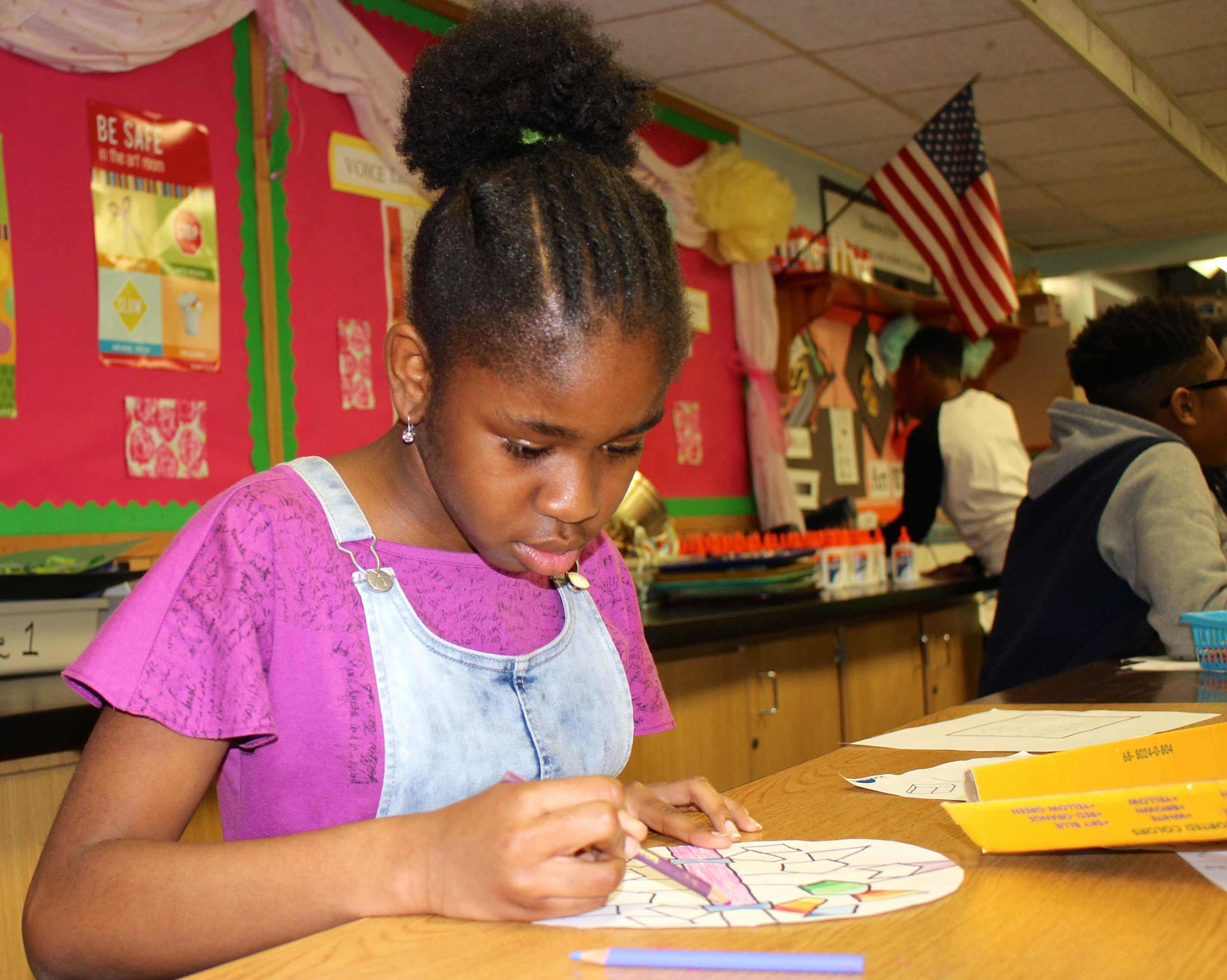 Sixth-grader Alexandria Charles used colored pencils to shade in her mandala during a recent math lesson at Gotham Avenue Elementary School.