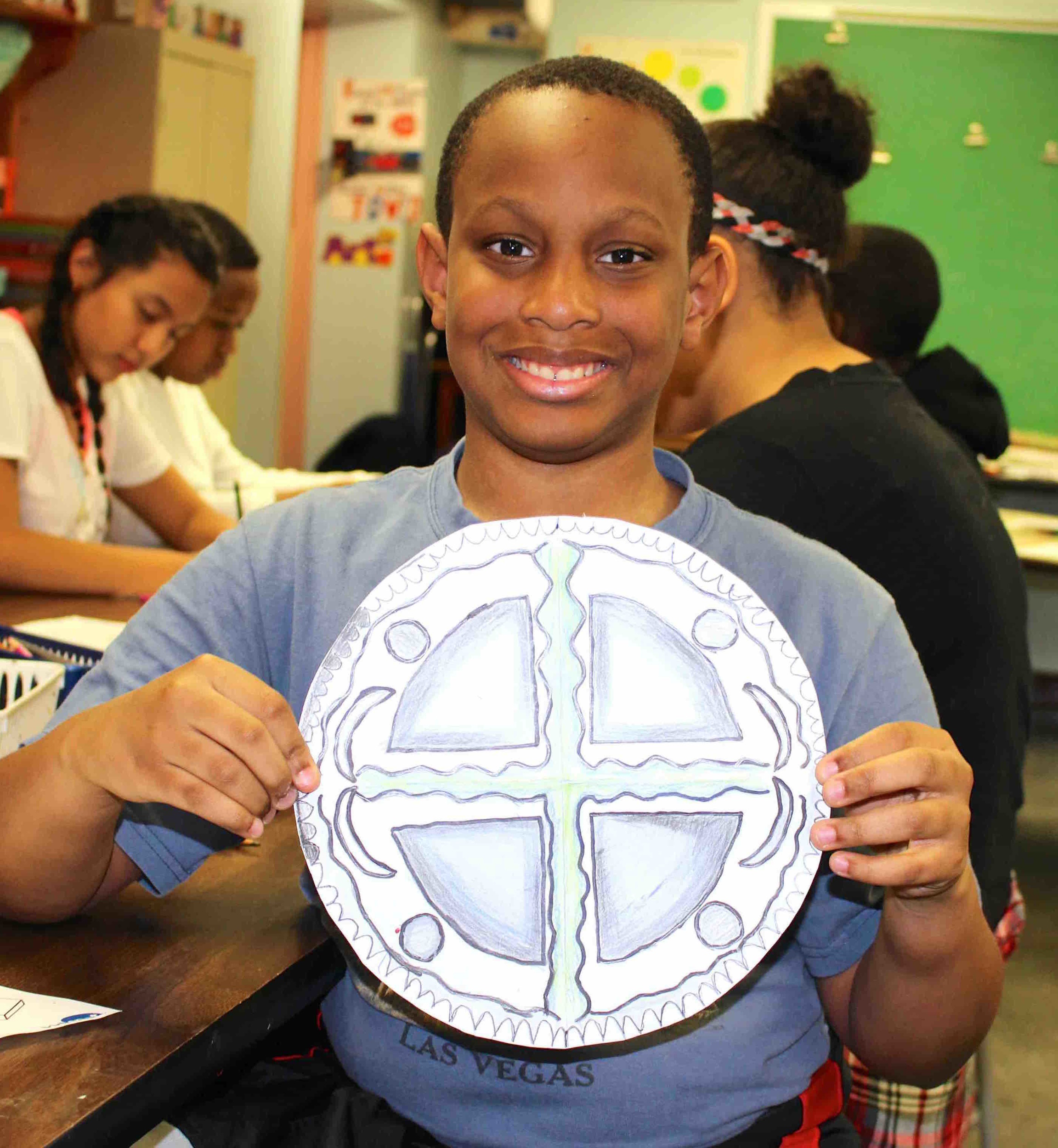 Lucanthony Angrand showed off the symmetry of his mandela during the class lesson.