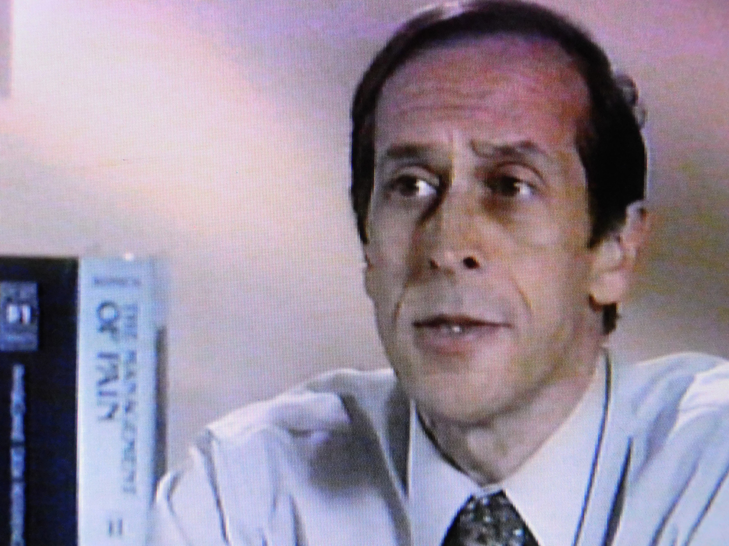 In a Purdue Pharma video that Belfiore and his attorney plan to use as part of their defense, Dr. Alan Spanos, pictured in a still from the video, extols the virtues of opioid pain medications such as Oxycontin.