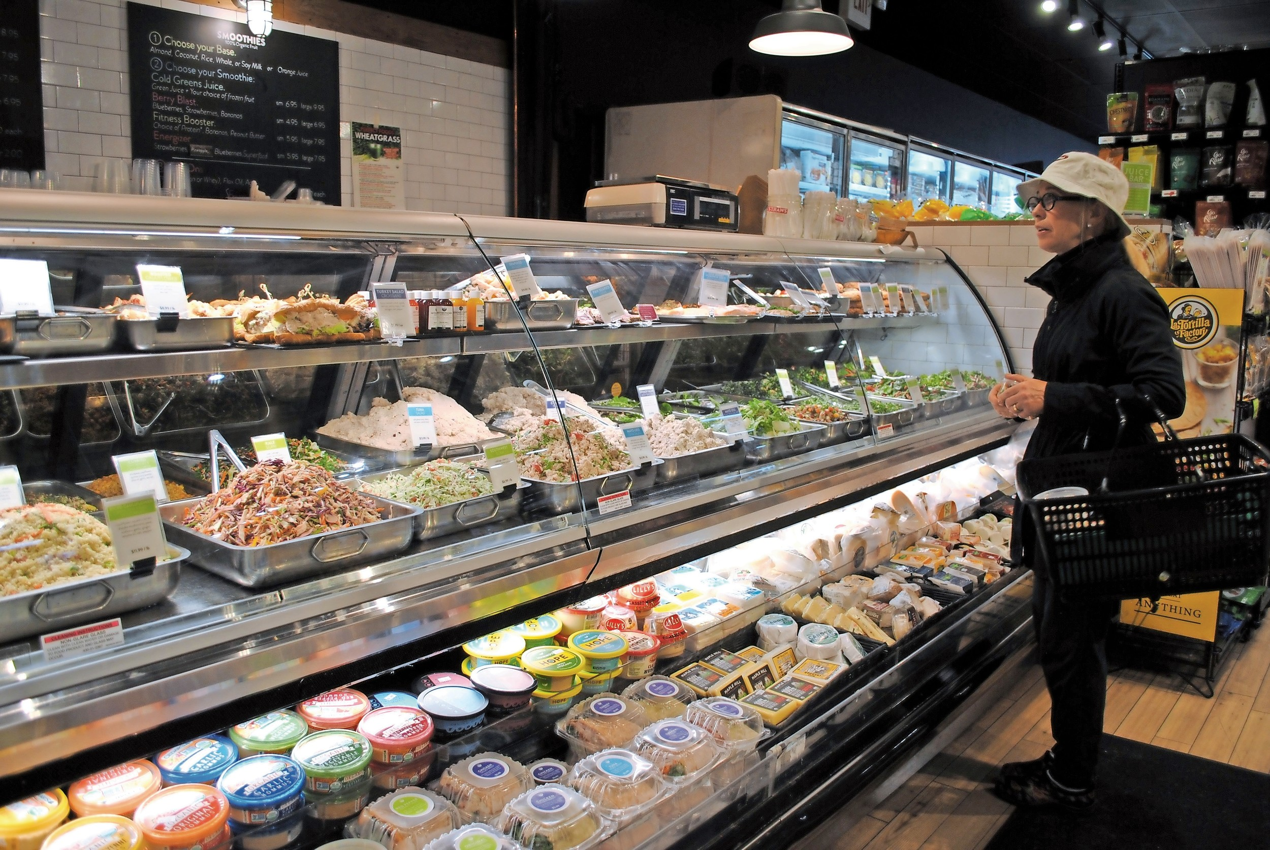 "Glen Cove resident Robin Wagner, a long-time customer of Rising Tide Market, said the store always has ""terrific, fresh food."""