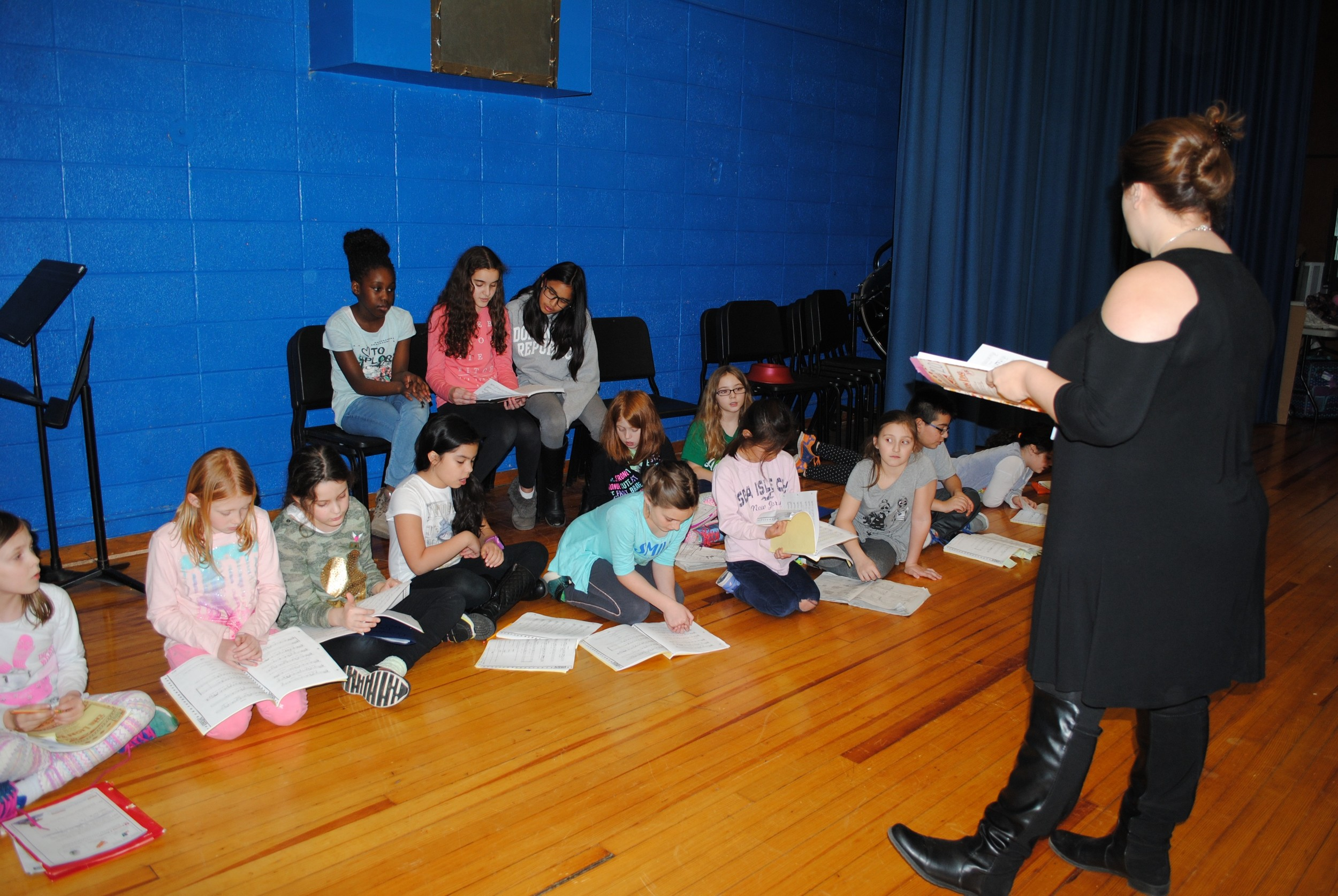 Director Teriann Chiappardi and the students practiced a song from the play during a rehearsal.