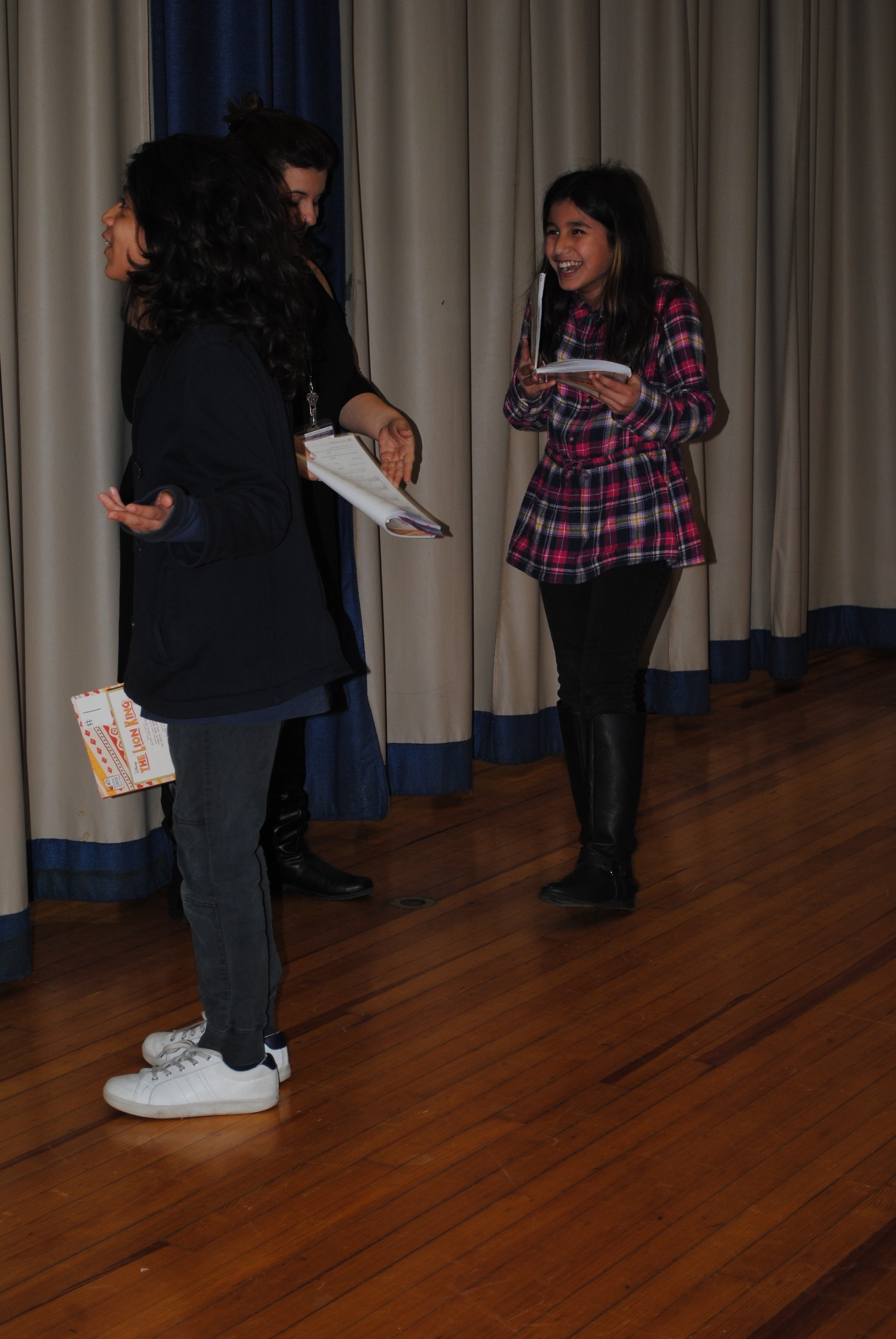 Jaiya Chetram, left, and Valerie Cotto, while playing adult Simba and Nala, broke character during a rehearsal.