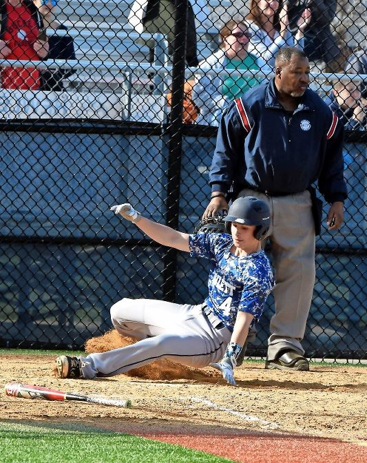 Senior Jesse Metz crossed the plate safely for one of Hewlett's runs in its 5-4 home victory over Roslyn on April 13.