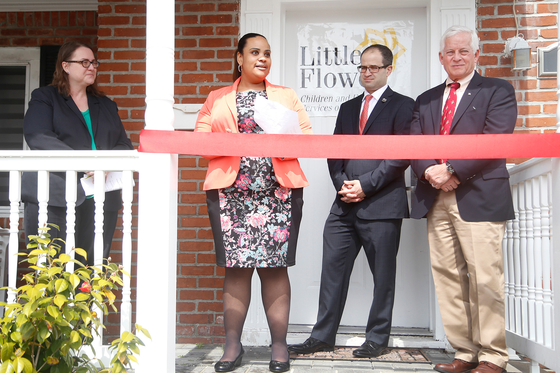Corinne Hammons, CEO of Little Flower, Tanisha Washington, VP, Assemblyman Ed Ra and Assemblyman Chuck Lavine.