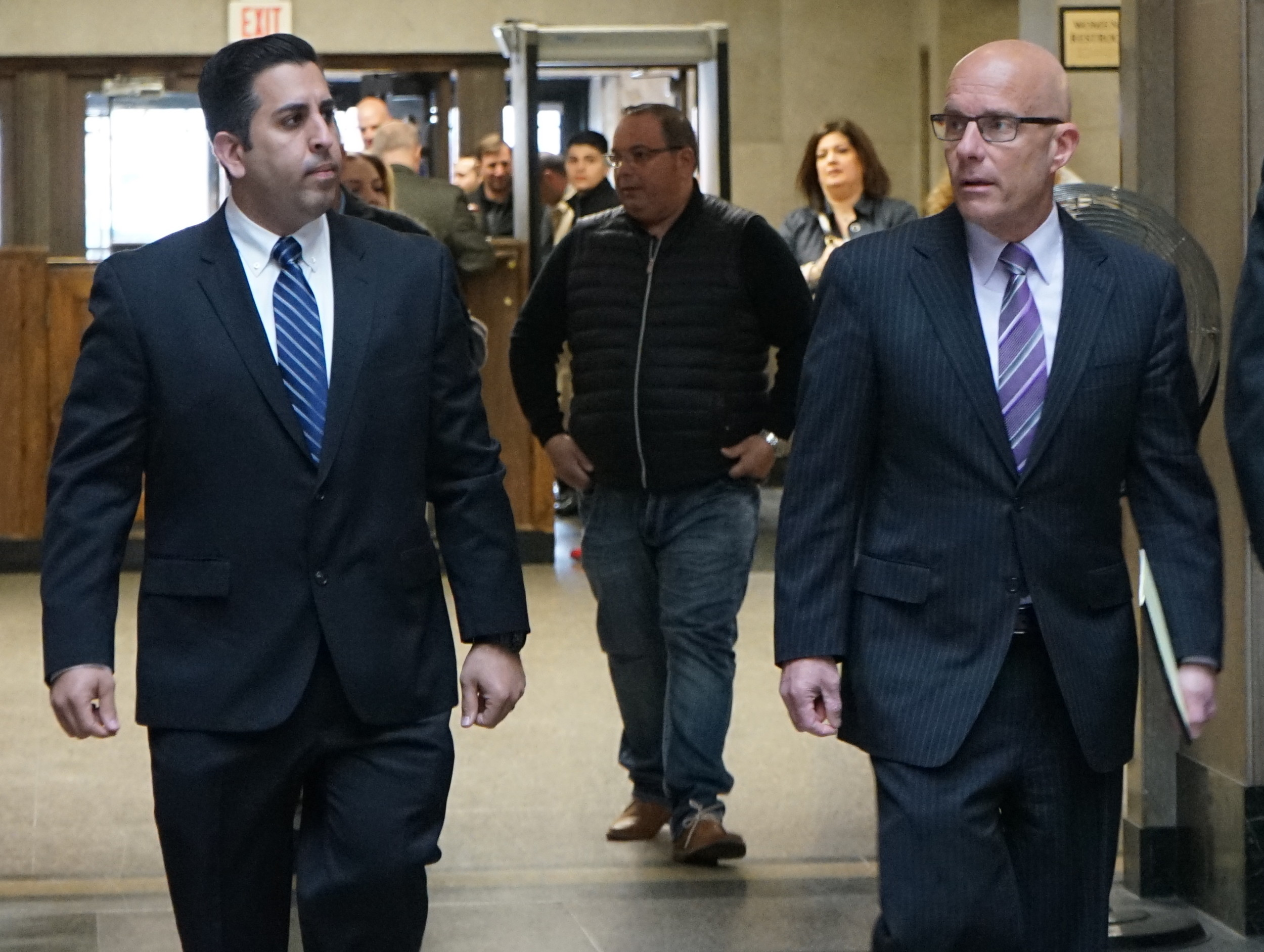 Rockville Centre police officer Anthony Federico, left, with his attorney William Petrillo at the Nassau County Courthouse on April 19.