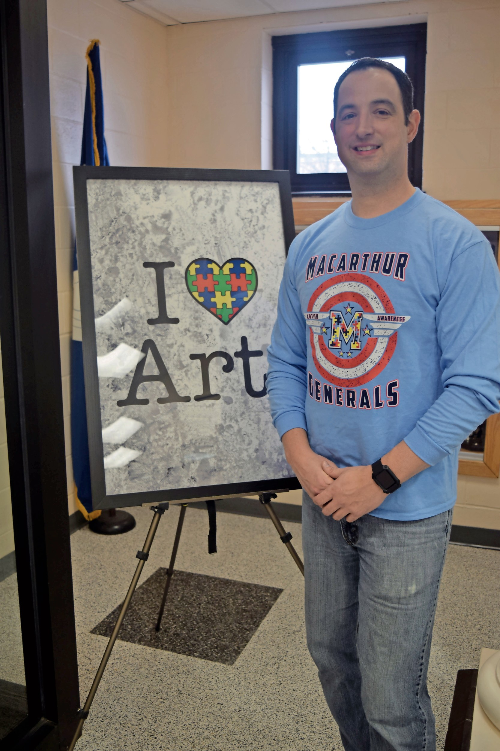 Vincent Causeman, a MacArthur High School social studies teacher, spearheads projects and events to raise awareness of autism and similar disorders in the high school and community.