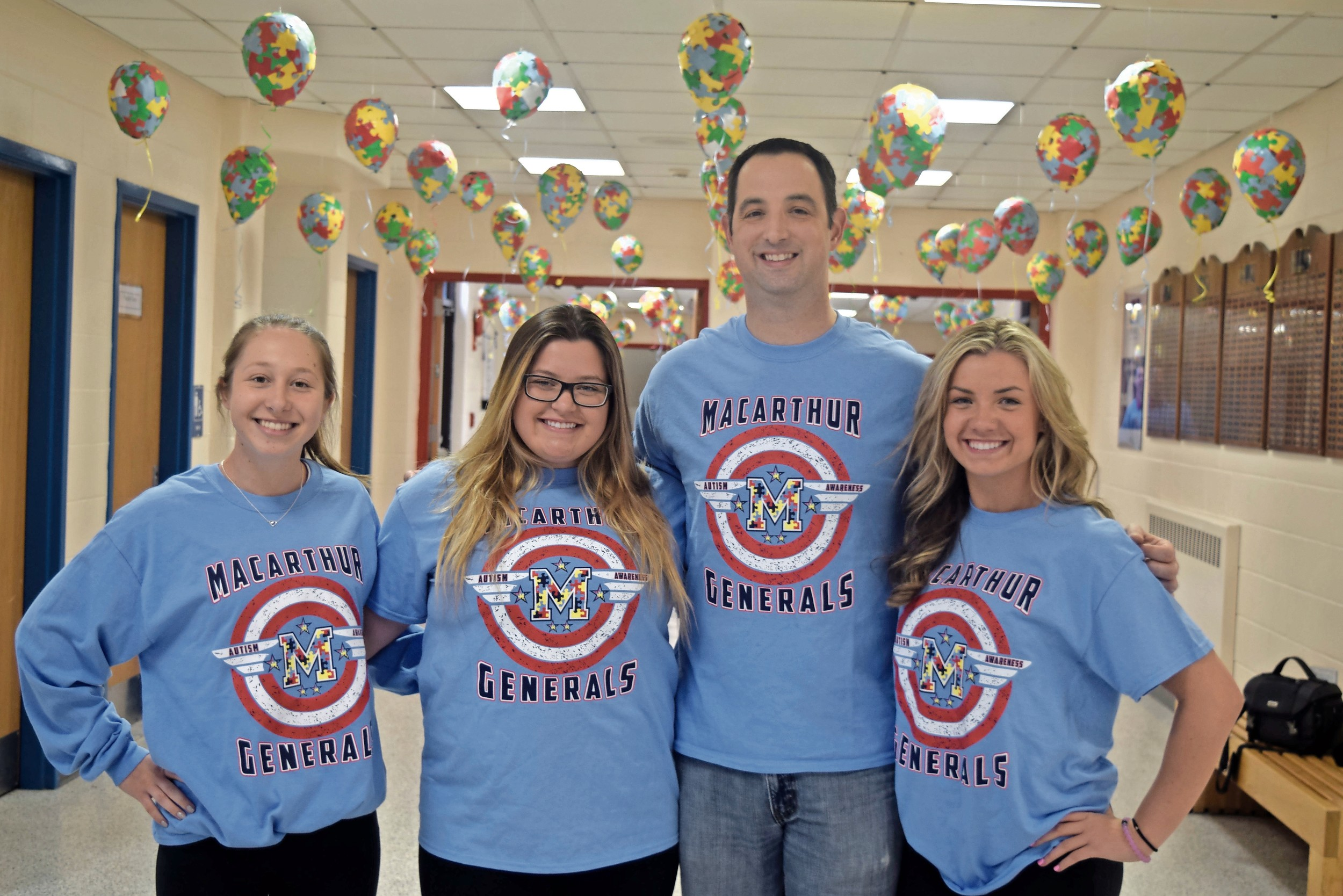 Seniors Katelyn Politi, far left, Ashley Arnold and Victoria Sullivan, here with Causeman, created decorations.