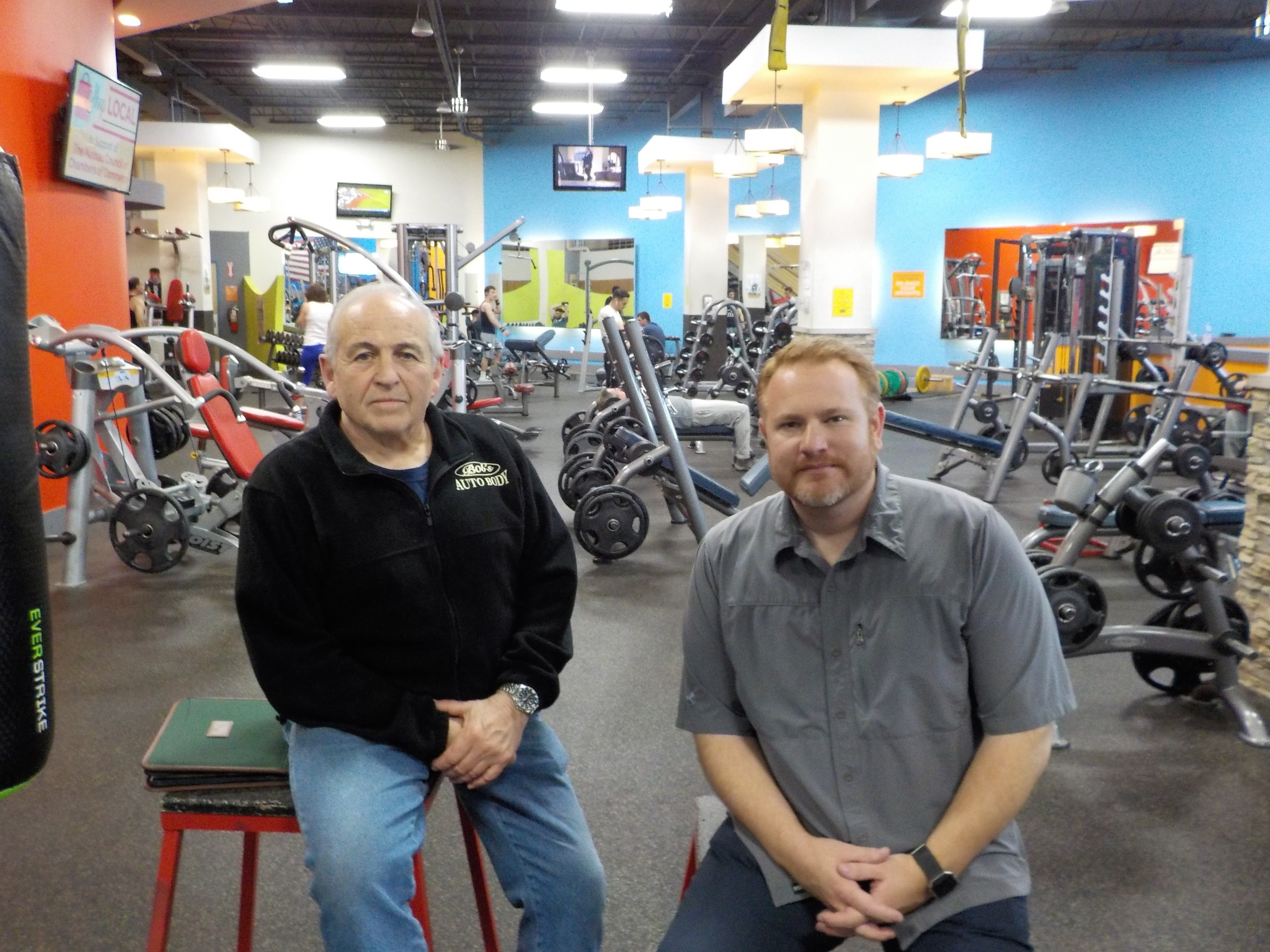 ROK Health & Fitness owners Robert D'Urso, left, and Mike Hawksby decided to give back to their members in  the form of rebate checks while celebrating their gym's fifth anniversary.