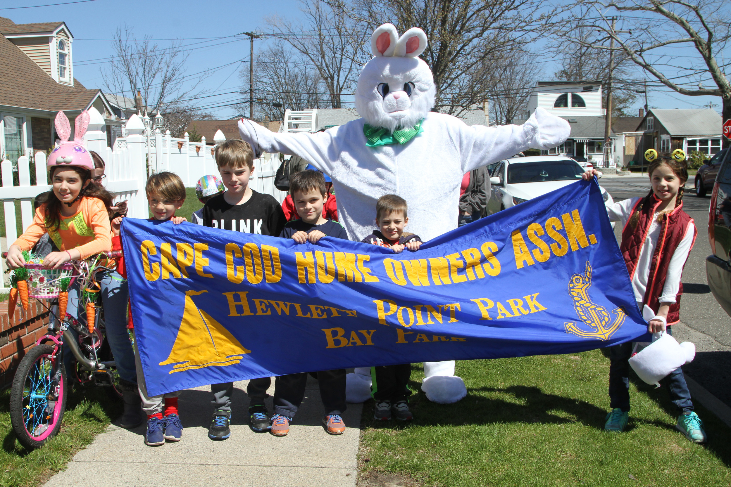 At the annual Cape Cod Homeowners Association Easter egg hunt, a parade was held for the very first time and led by the Easter Bunny.