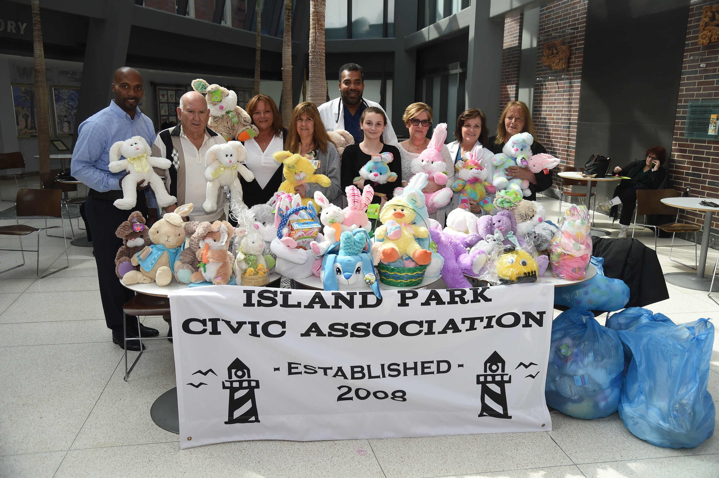 Steve Richardson, left; Nick DeMatteo; Dominica Califano; Lynn Bert, South Nassau Communities Hospital's nurse manager for pediatrics; Dr. Lincoln Ferguson, associate chairman of pediatrics; Pia Califano; Kerri Wagner, child and family life specialist; nurse Cecilia Carey; and Anna D'Amaro, former Island Park Civic Association president at the hospital on April 12.