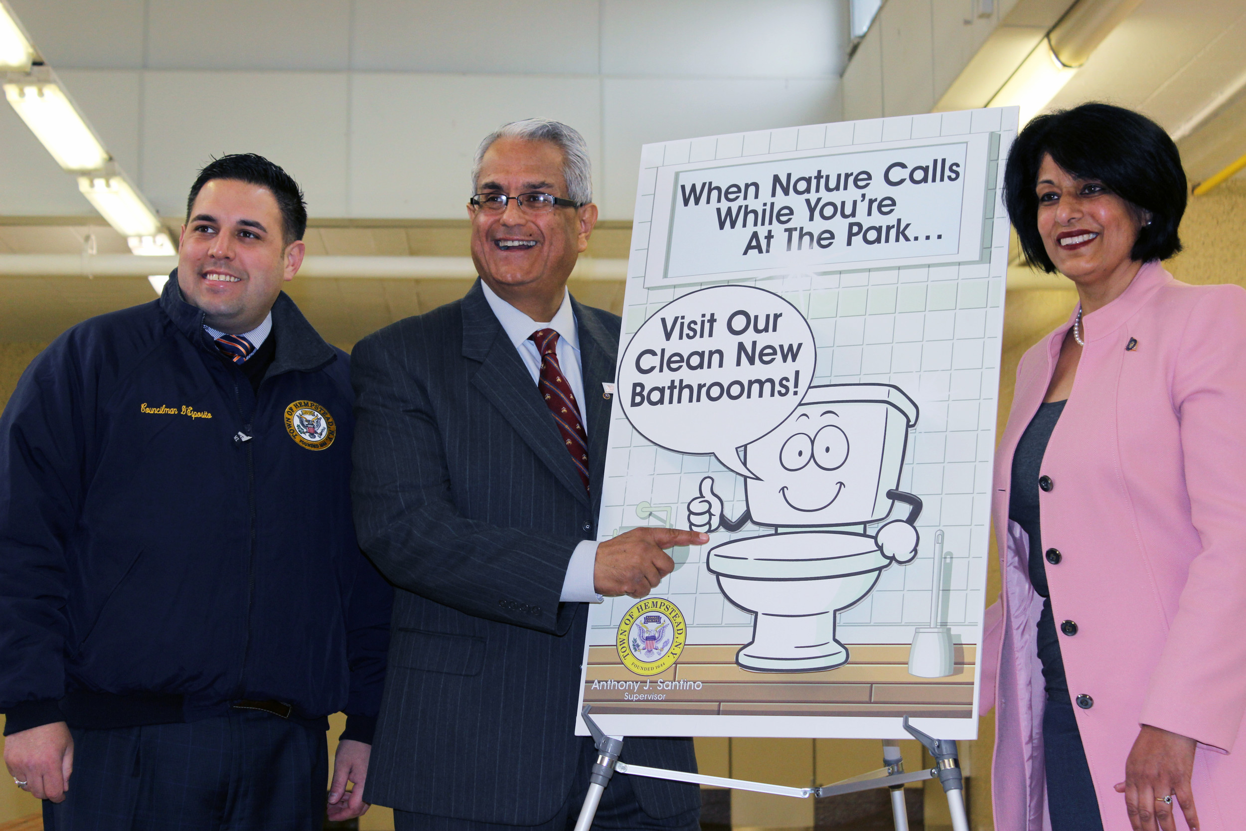 Councilman Anthony D'Esposito, left, Town of Hempstead Supervisor Anthony J. Santino, and Town Clerk Nasrin Ahmad unveiled a new sign to announce the restoration of multiple town recreation facilities.