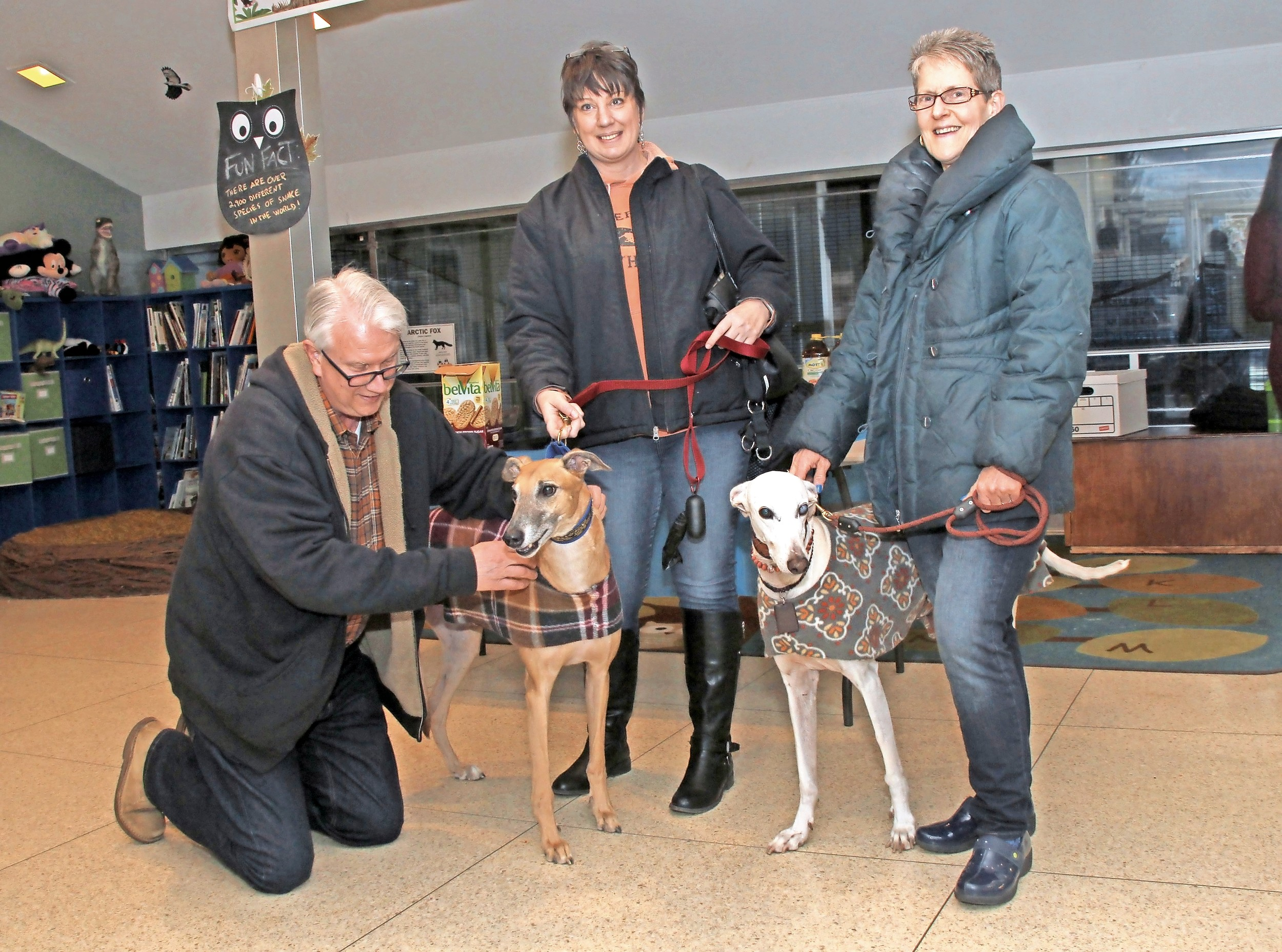 Peter Ruffner, left, a Friends of Tackapausha board member, met Liz Perry and her greyhound, Murphy; and Nancy Nelson and her dog, Pablo.
