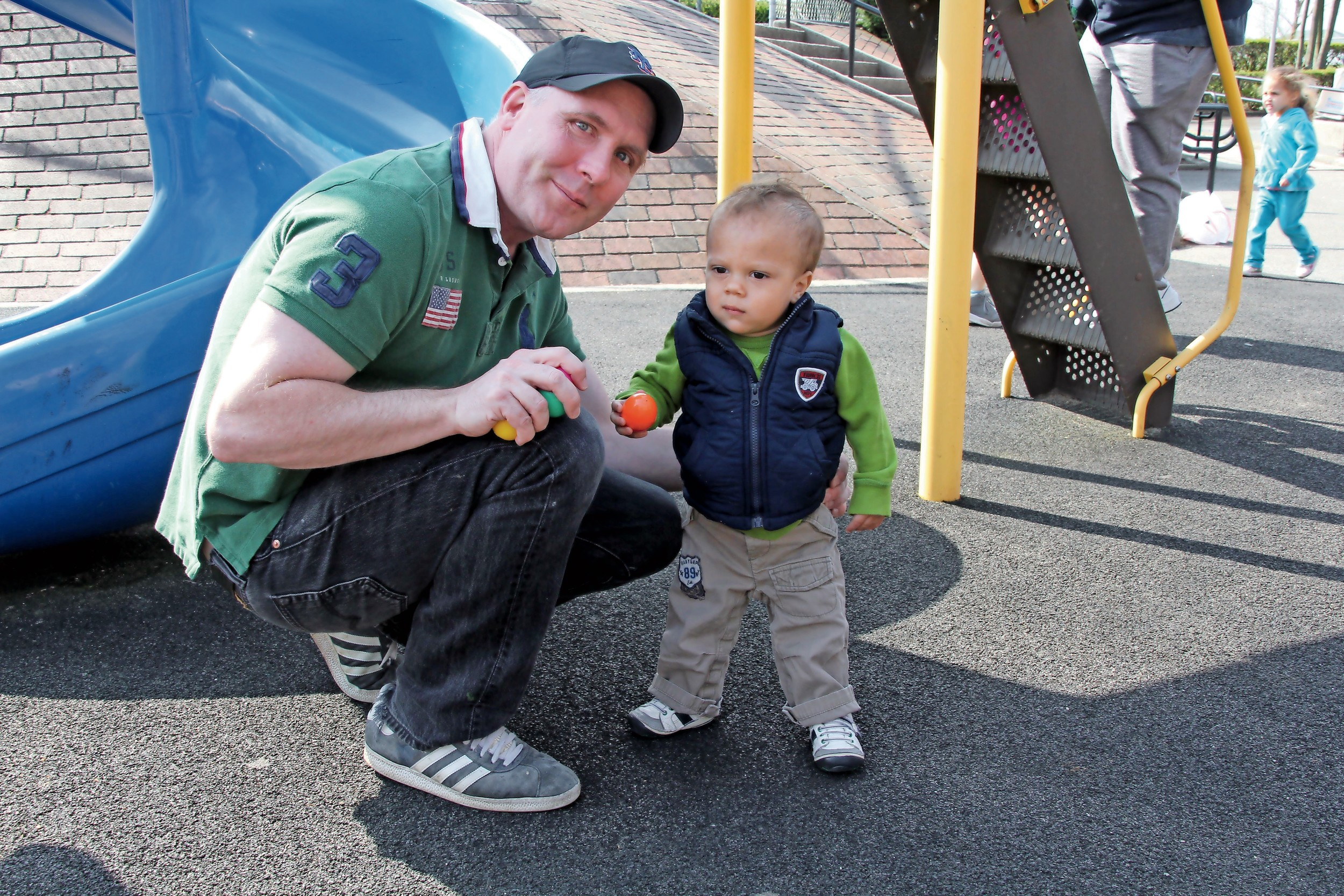 Thomas Lucas helped his son Donovan, 17 months, find an egg for his basket.