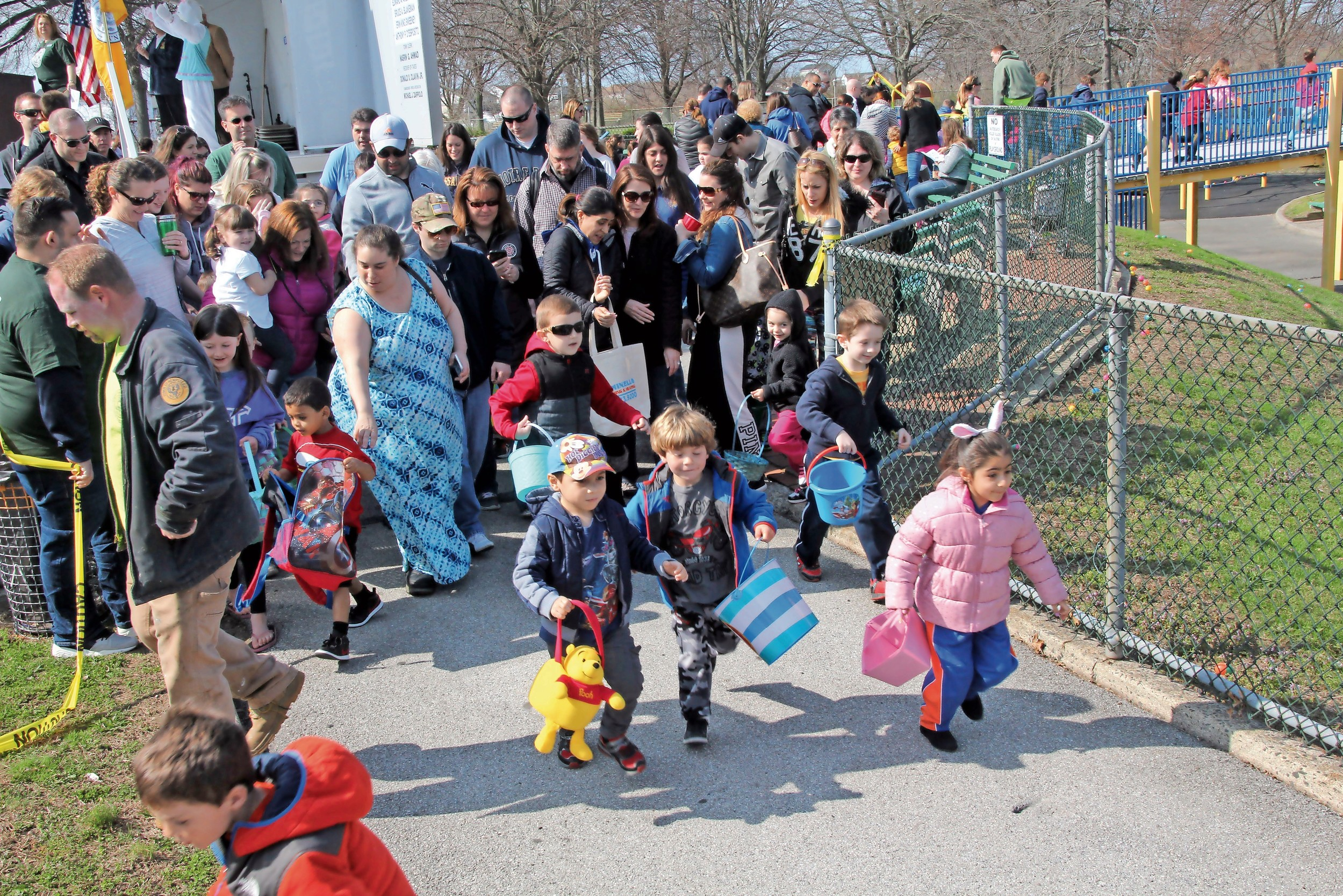 children ran through the gates of Seamans Neck Park playground at the Seaford Chamber of Commerce annual Easter Egg Hunt on April 15.