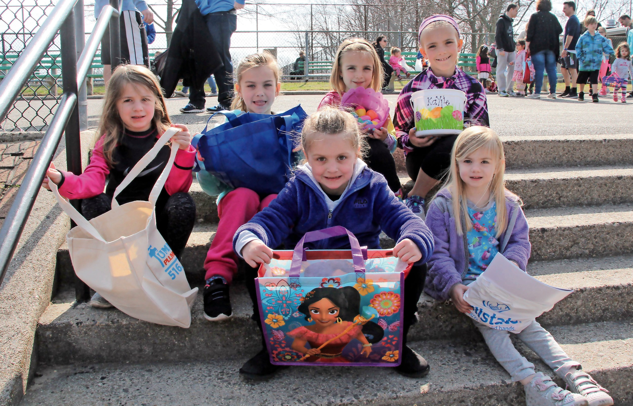 Dozens of children filled baskets with treats last Saturday at the Seaford Chamber of Commerce Easter Egg Hunt at Seamans Neck Park. Clockwise from left were Charlotte Barodin, Bella Doering, Leah and Kaylie Conklin, Charley Dowering and Rosalie Barodin.
