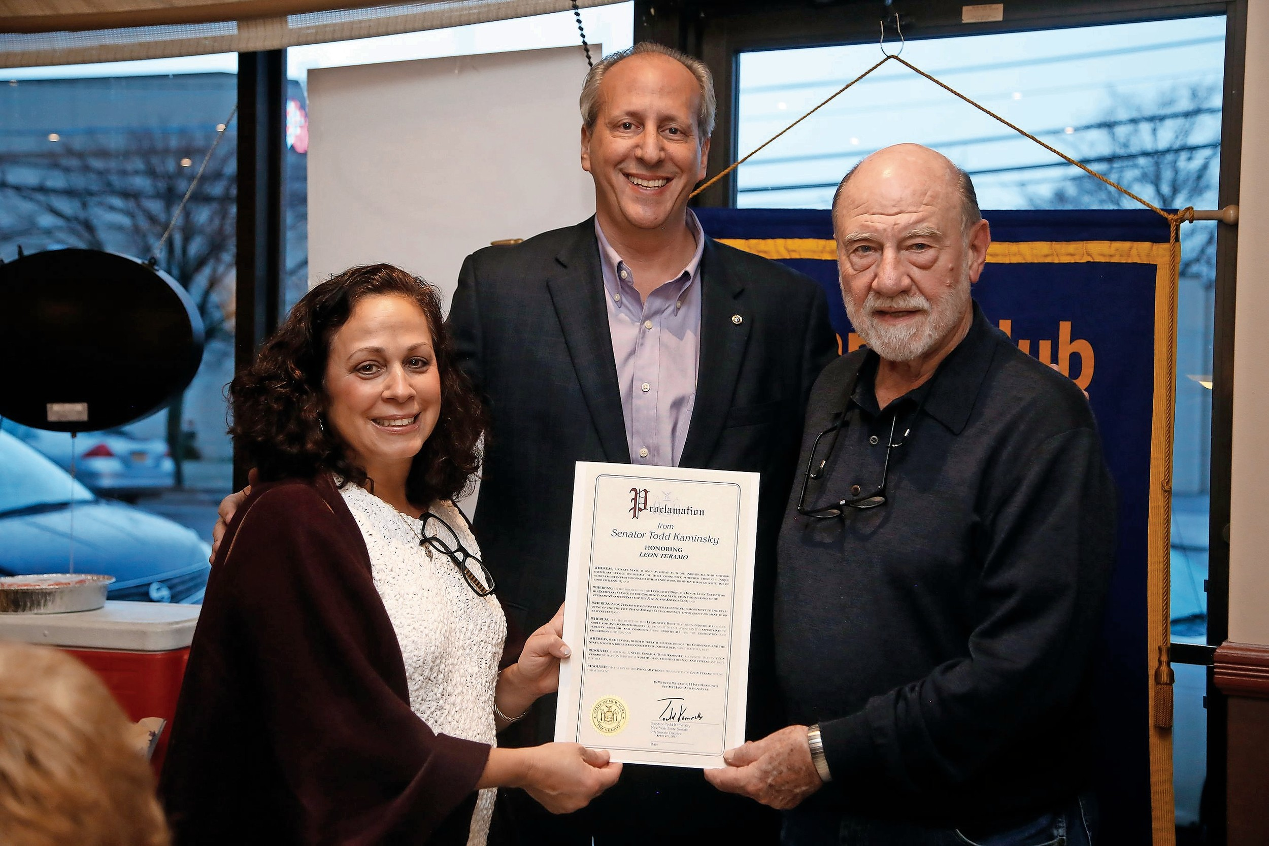 Longtime Kiwanis member Ponte Teramo, right, was given a citation from State Sen. Todd Kaminsky (D-Long Beach) by Ada Cruz. Club President Tom Cohen, center, congratulated Teramo.