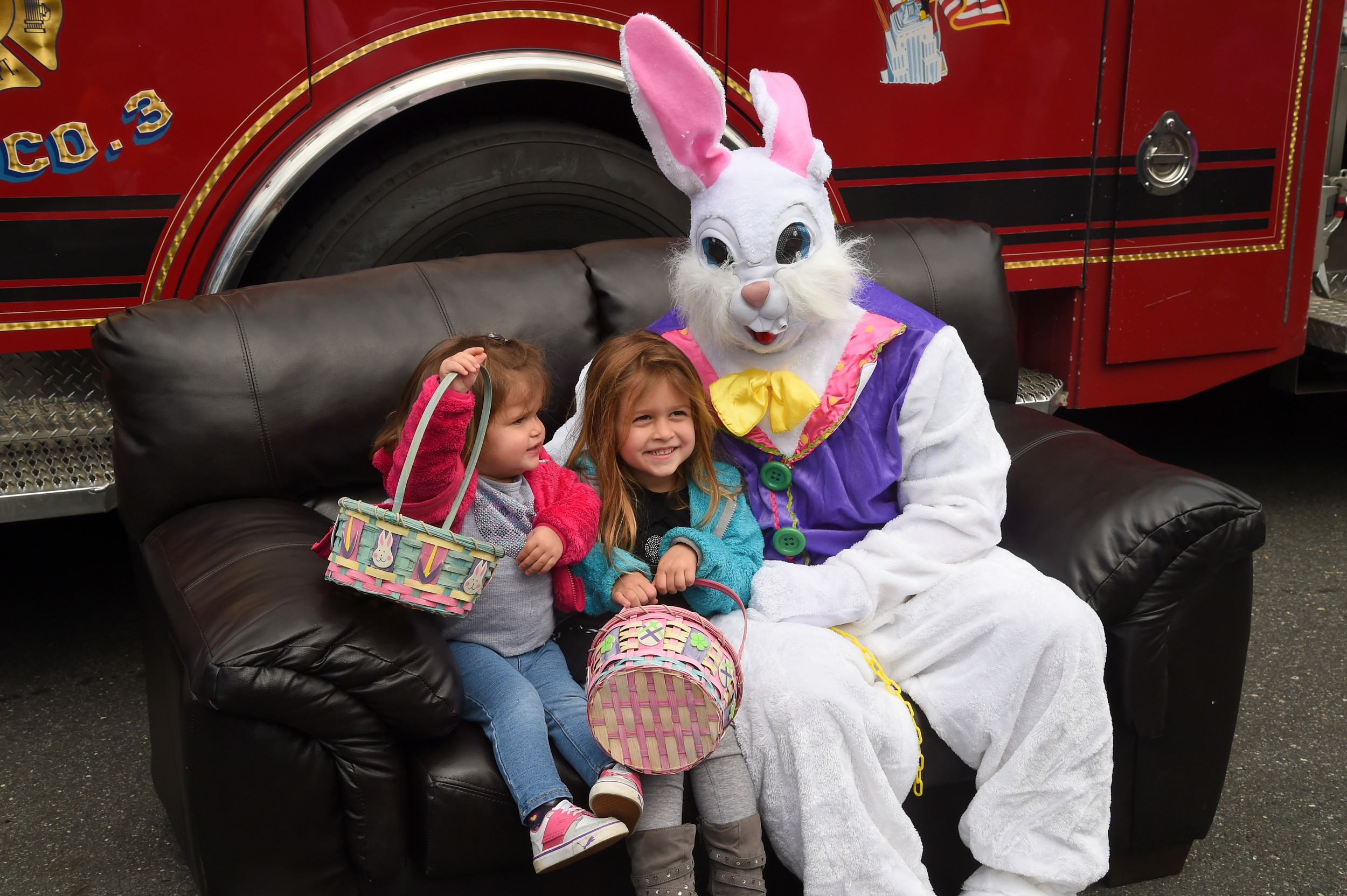 Ashley and Brianna Blitz, 1 and 4, sat for pictures with the Easter Bunny.