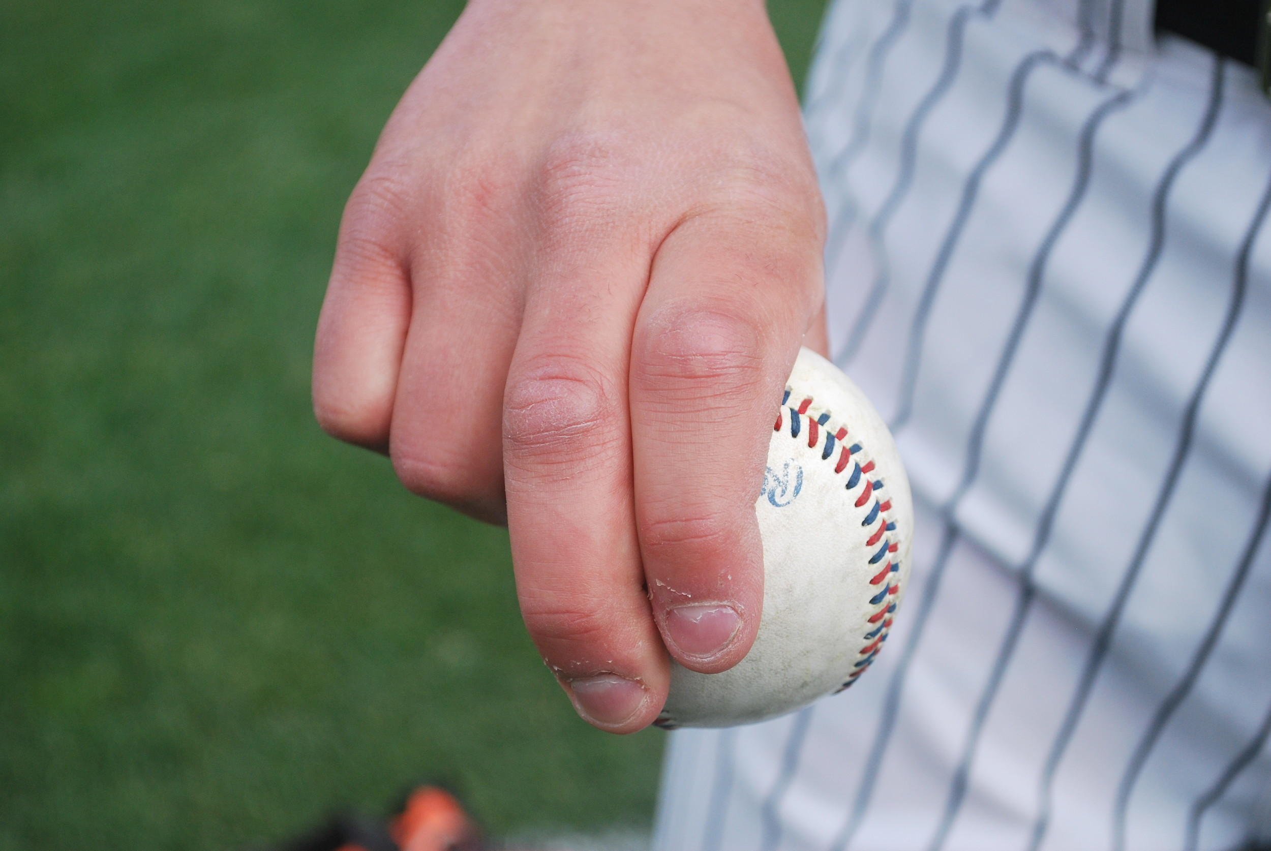 Long Island Ducks right-hander Keith Couch demonstrated how he grips his breaking ball.
