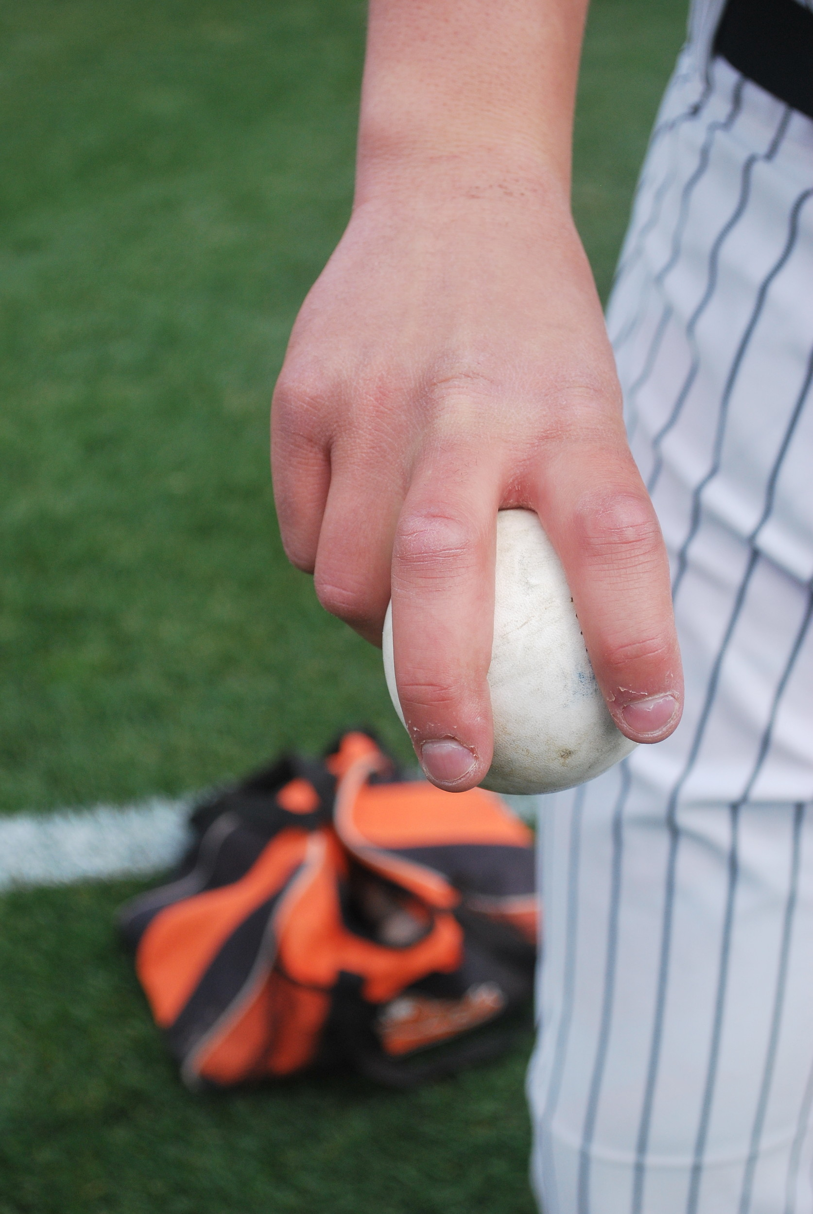 Long Island Ducks right-hander Keith Couch demonstrated how he grips his two-seam fastball.