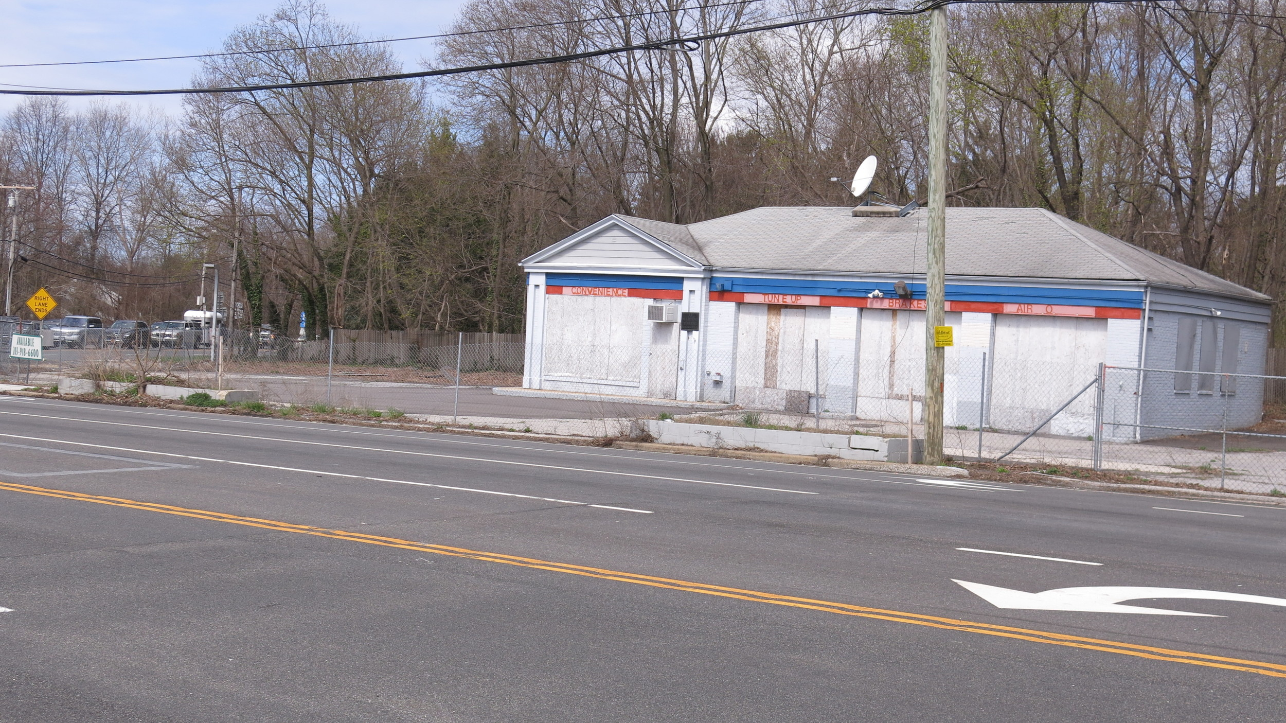 People are worried that the abandoned gas station on the corner of Route 25A and 107 may become a Starbucks.