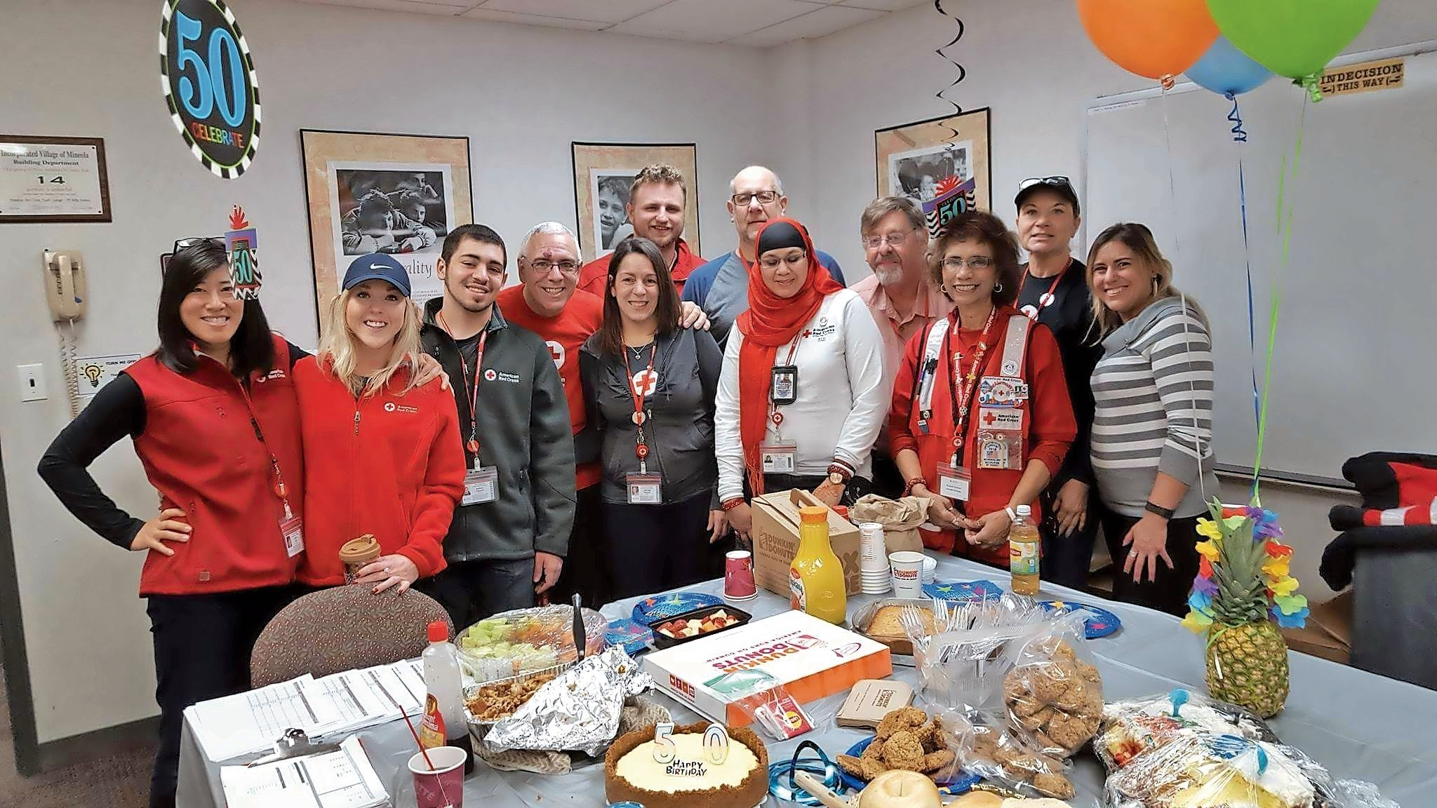 Red Cross volunteers helped Joe Spaccarelli, director of the Home Fire Preparedness Program, celebrate his 50th birthday before heading out to install smoke detectors for those that need them.