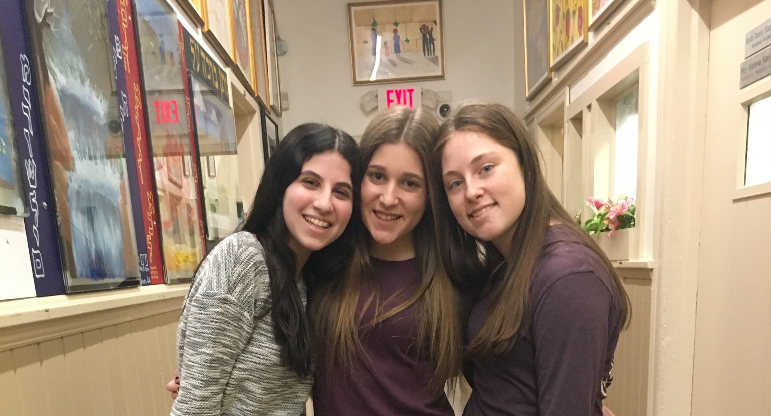 SKA's student newspaper, The Looking Glass, is currently led by co-editor-in-chief Shoshana Reichman, left, layout editor Danielle Greenfield, layout editor, and co- editor-in-chief Elisheva Greenberg.