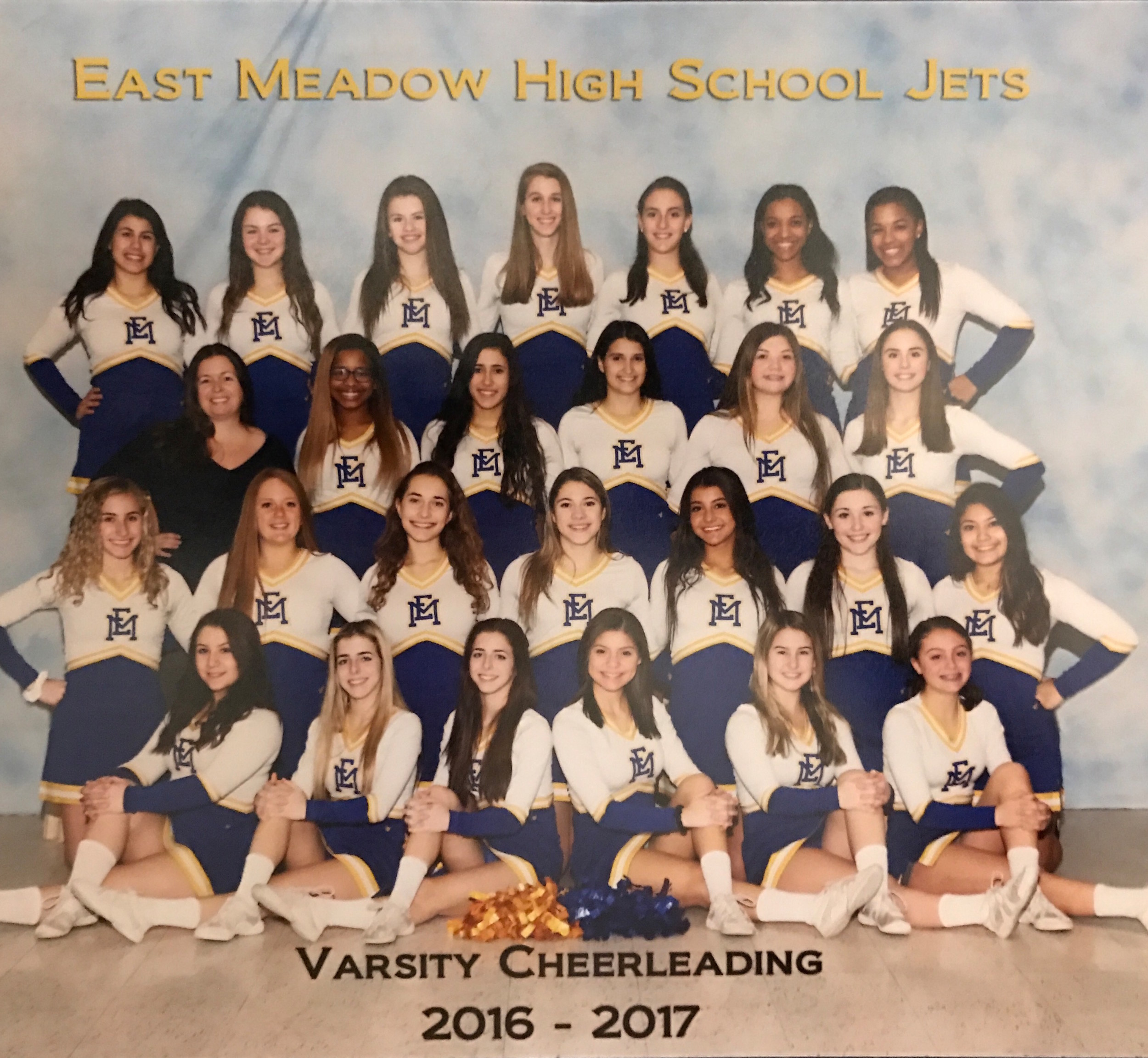 The East Meadow High School's varsity cheerleading team, 2016-17.