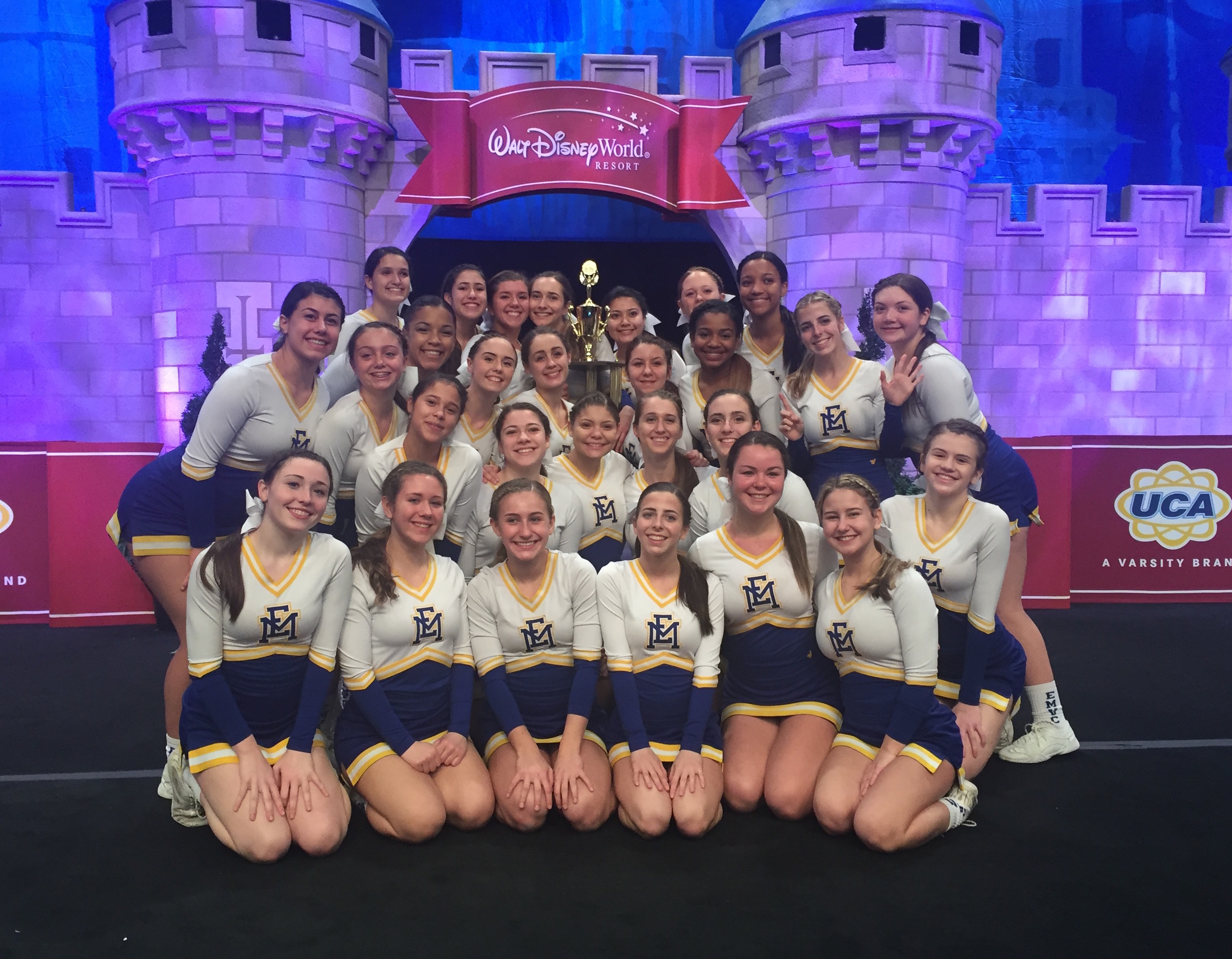 The East Meadow High School varsity cheerleading team was the first team in the school's history to compete in both the national and state championships, while also securing a historic first-place win in the county competition. Above, the team at Walt Disney World.