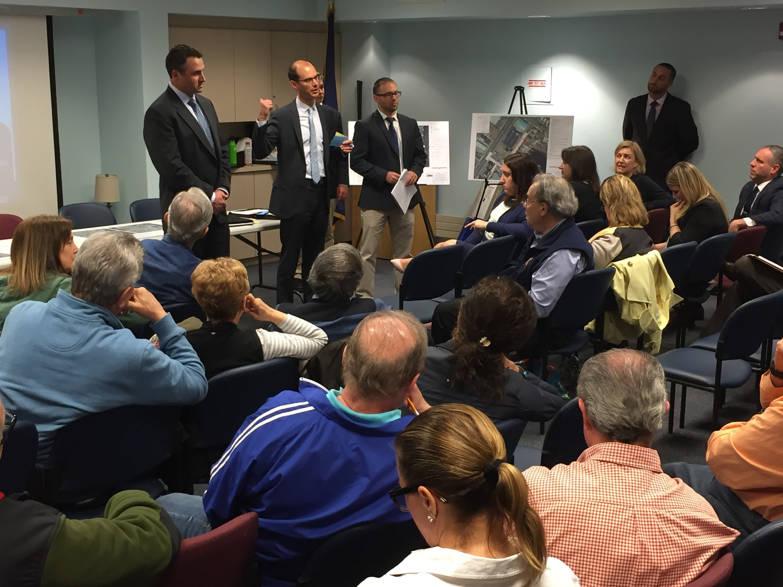 Sean Sallie, planning division supervisor for the Nassau Department of Public Works, center, helped answer residents' questions after a presentation outlining seven storm drainage mitigation projects.
