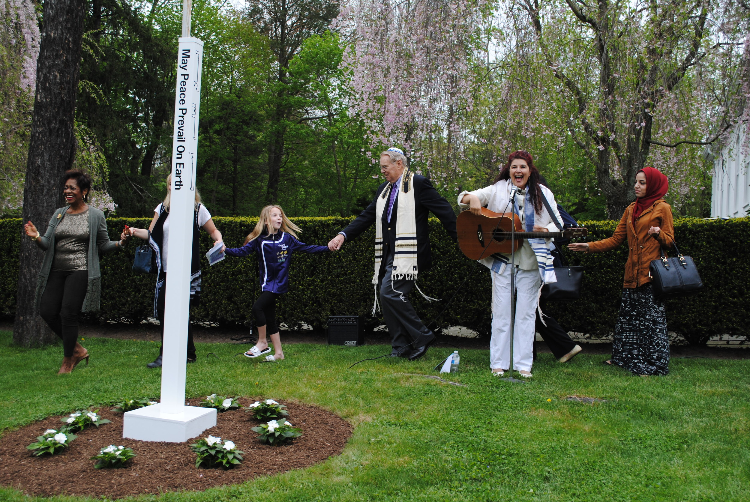 Cantor Irene Failenbogen, who sang several traditional Jewish songs, inspired everyone to dance in celebration of the Peace Pole.