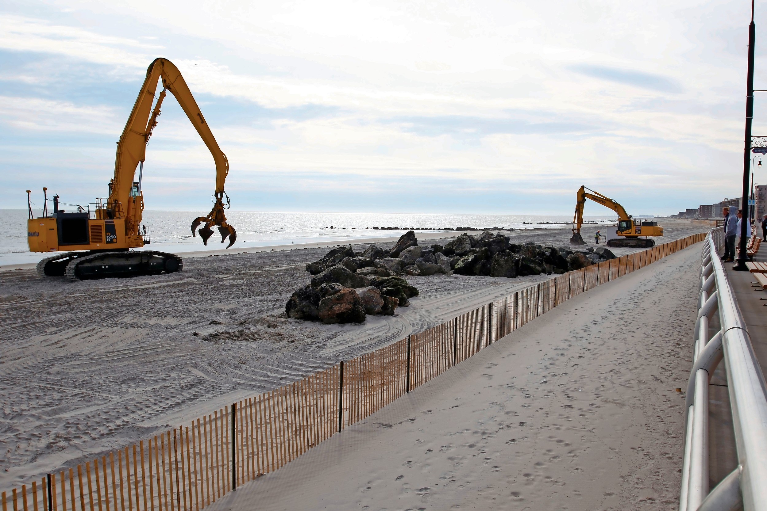 2435e14b2a950 People gathered on the boardwalk at Riverside Boulevard earlier this month  to watch crews rebuilding a