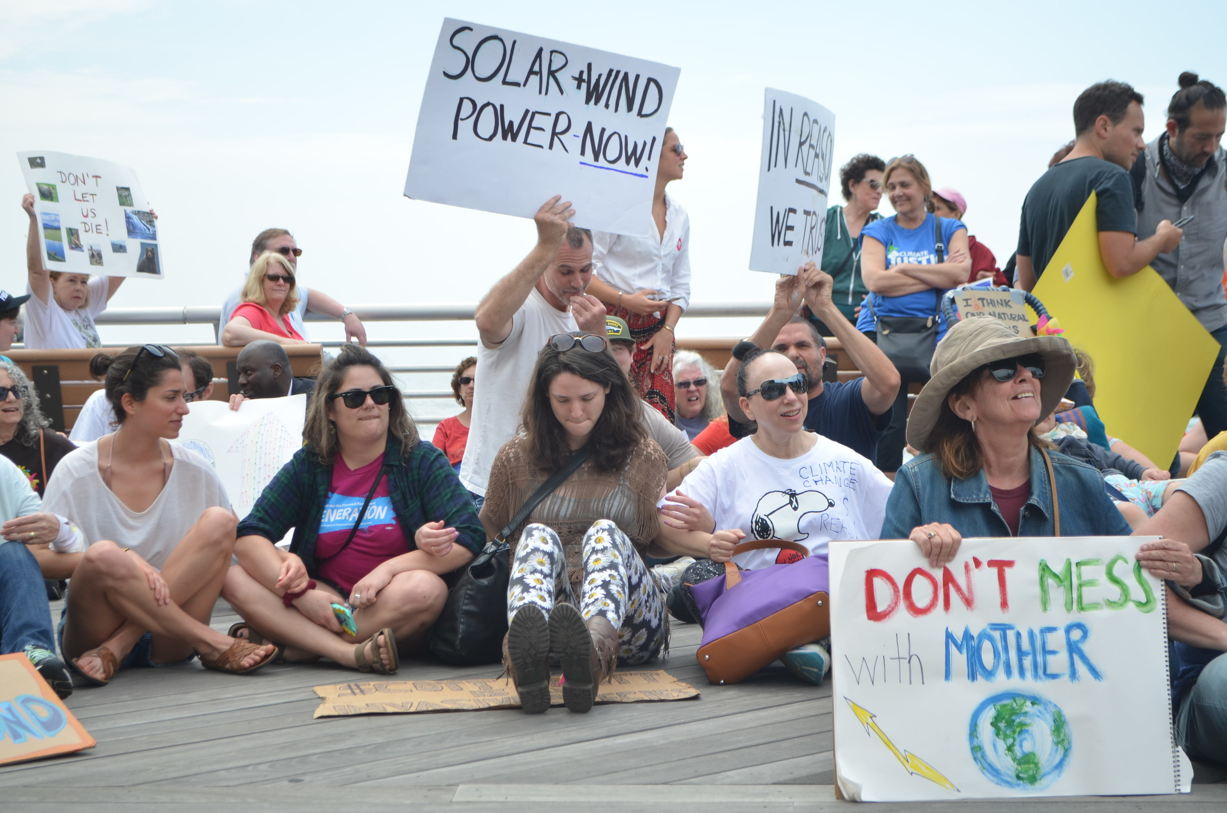 Organizers of the event asked protesters to sit down on the boardwalk, link arms and observe a minute of silence — as did participants in other marches around the country.