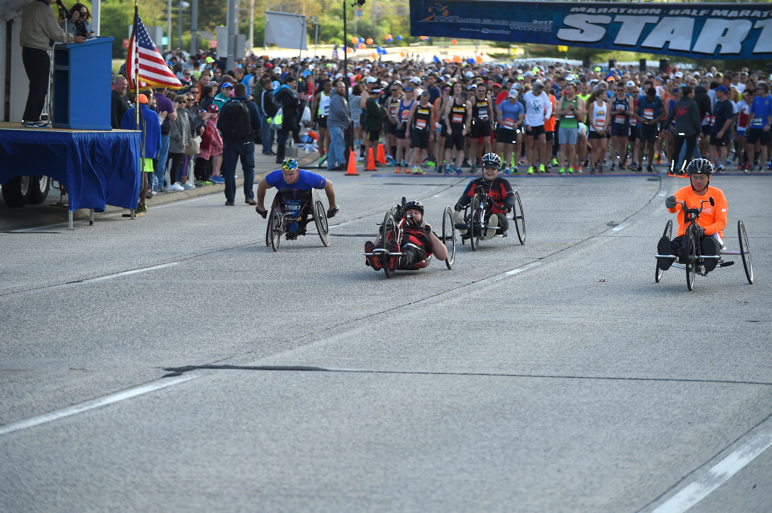 About 5,000 people, on feet and on wheels, take part in the Long Island Marathon.