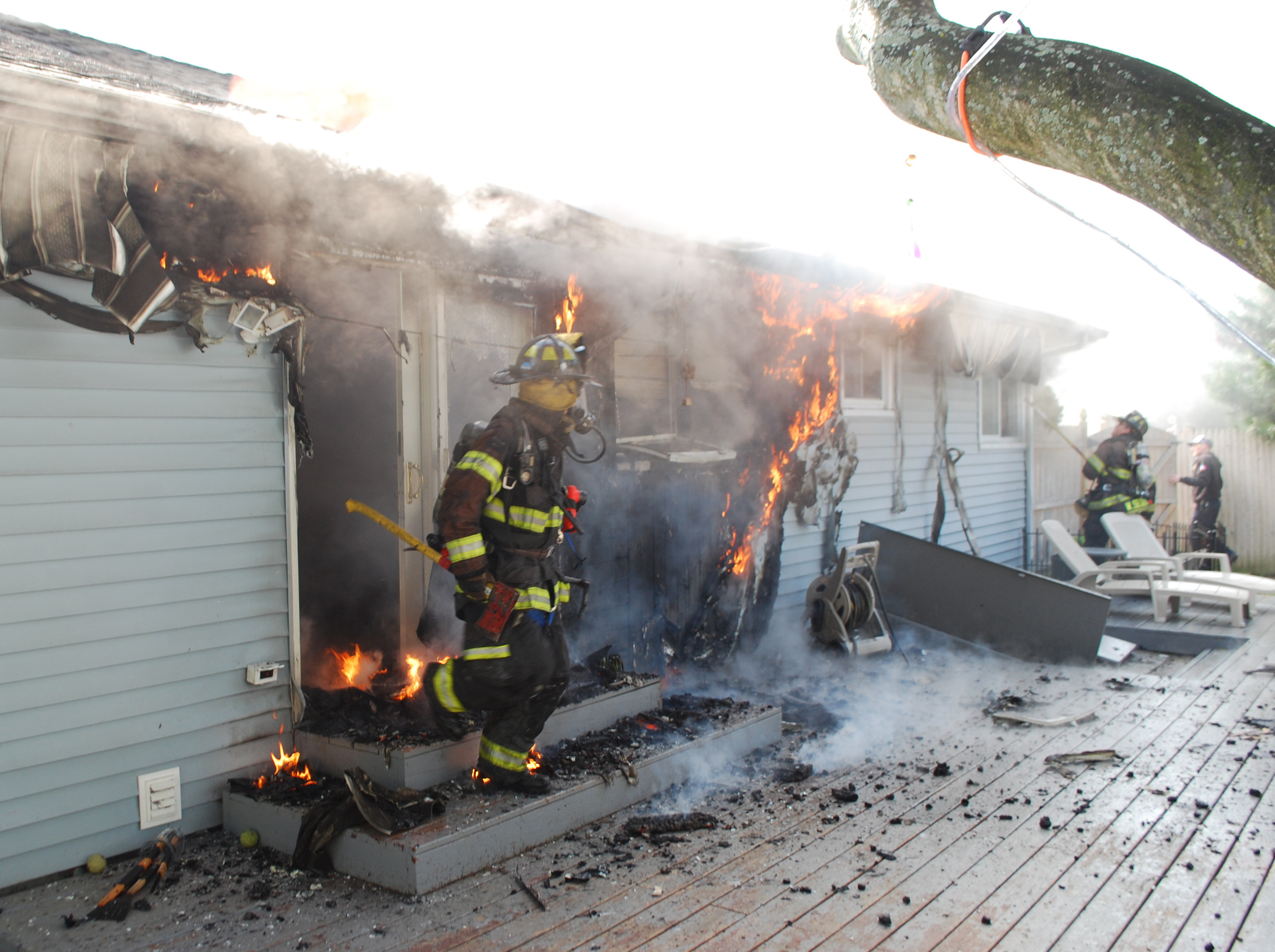 The blaze at the Consentino house began toward their back porch and spread up the back of their house, said Chris Fasano, the North Merrick Fire Department's second assistant chief.