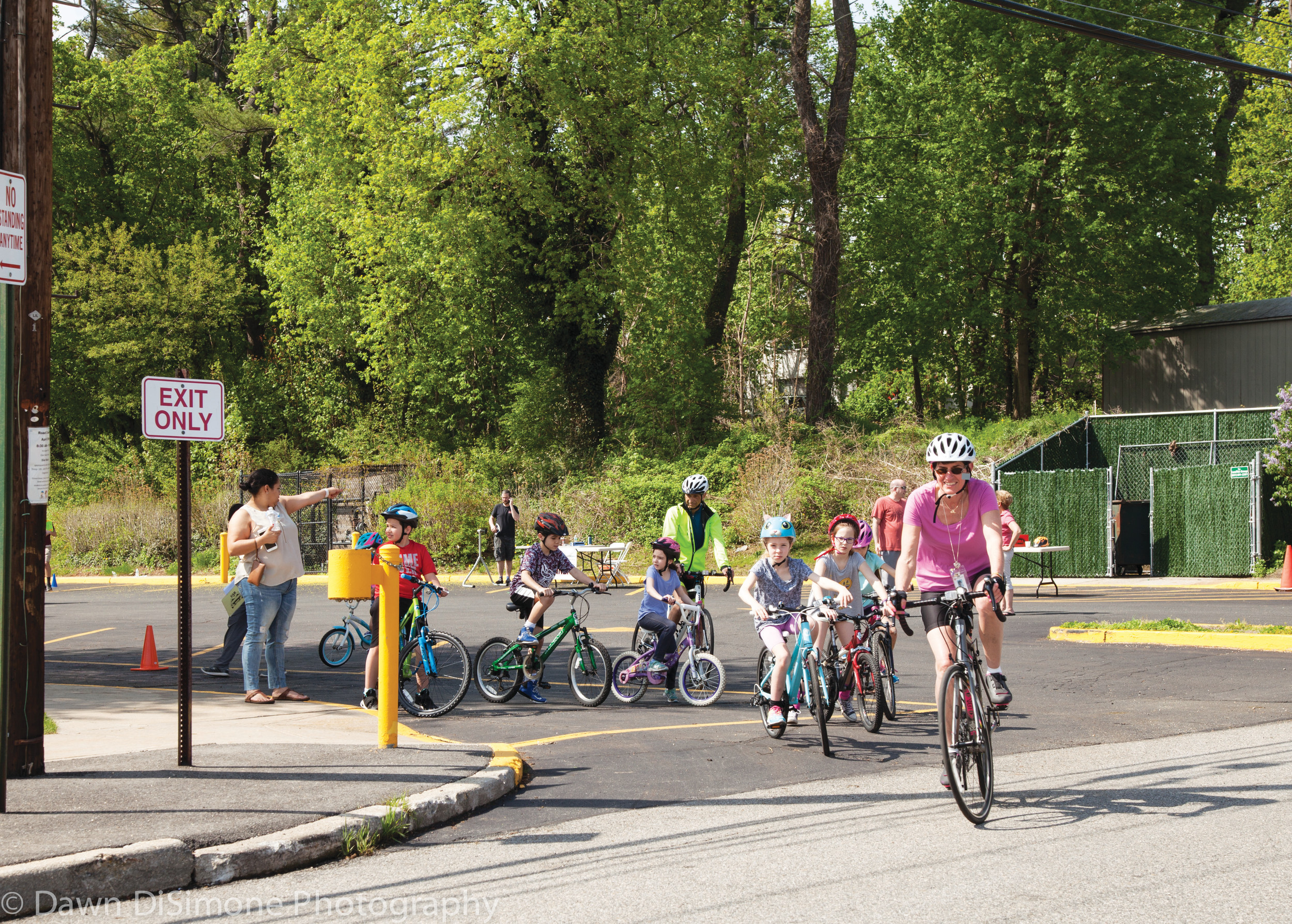 Glen Head Elementary School Principal Lori Nimmo led the way for student cyclists at the AAA Bike Rodeo.