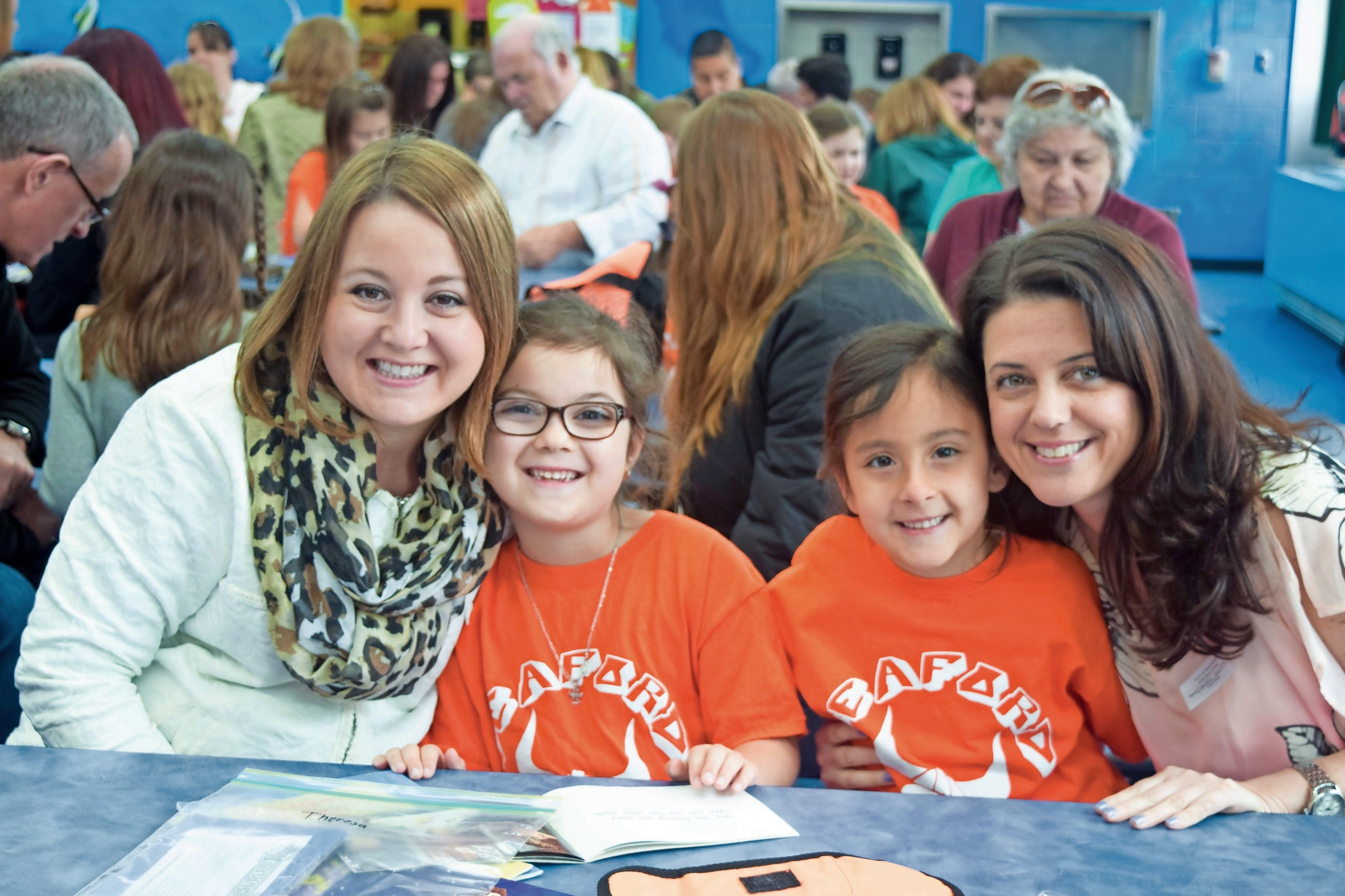 Seaford Harbor Elementary students invited friends and family to a Special Someone Day event on May 5. Christine Scannello, left, Theresa Scannello, Julianna Gonzalez and Connie Gonzalez worked on a craft.