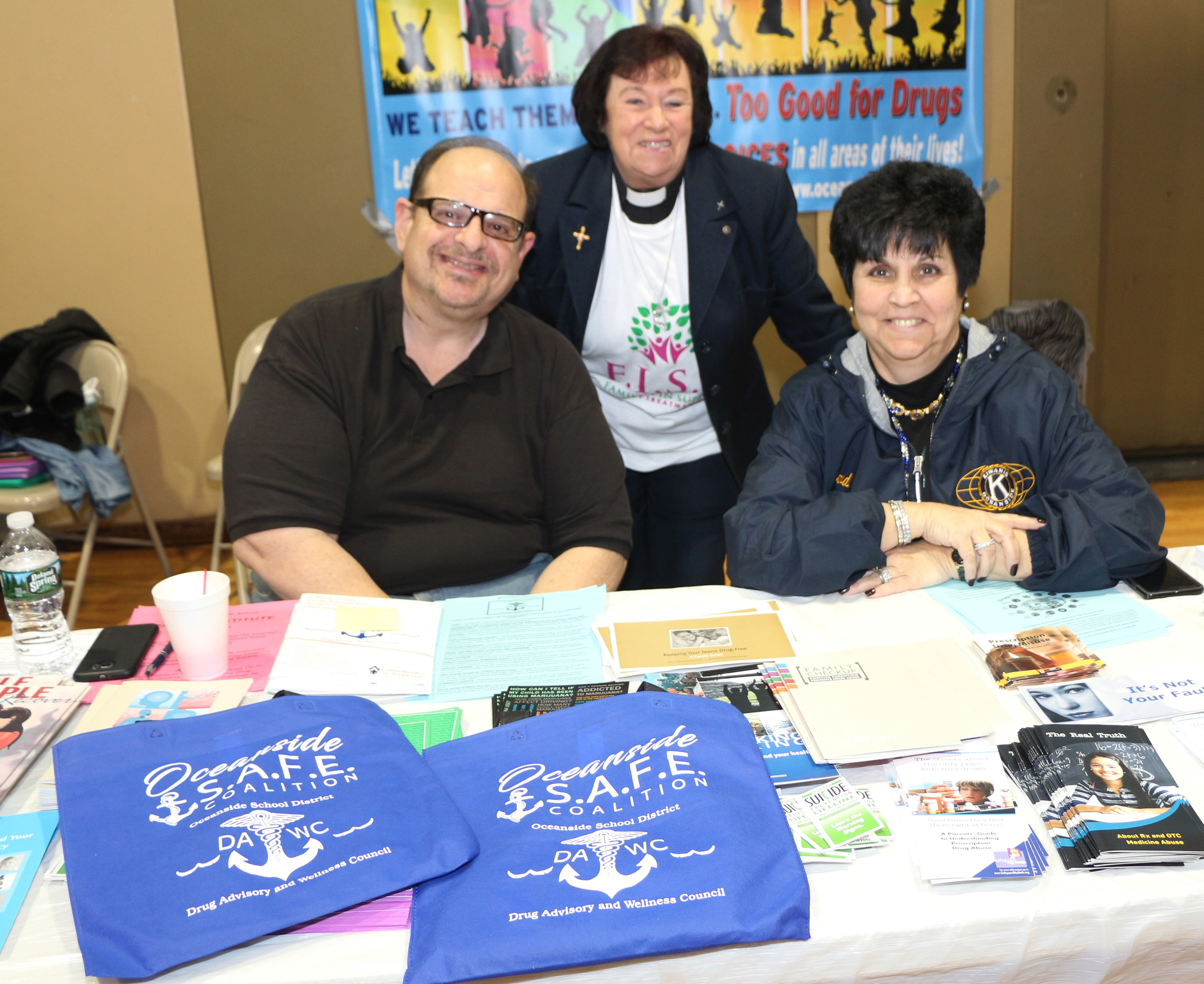 Oceanside SAFE Coalition members Herb Pitkowsky, the Rev. Janet Porcher and Sandie Schoell at an addiction resource fair at School No. 6 in March.