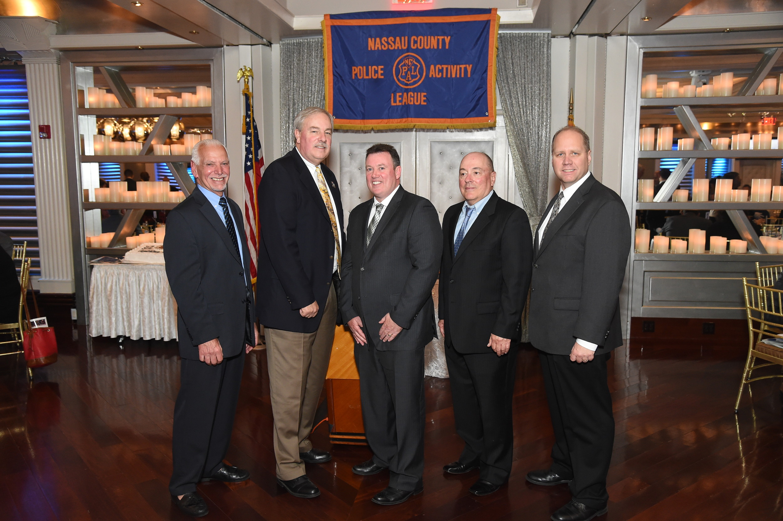 NCPAL President Frank DiVittorio, left, and Commanding Officers Sgt. Doug Kenah and Sgt. Rob Kiesel honored Chris Quinn, of the Wantagh-Seaford PAL, and Robert Pope, of the PAL Special Needs Unit, for their dedication to the organization.