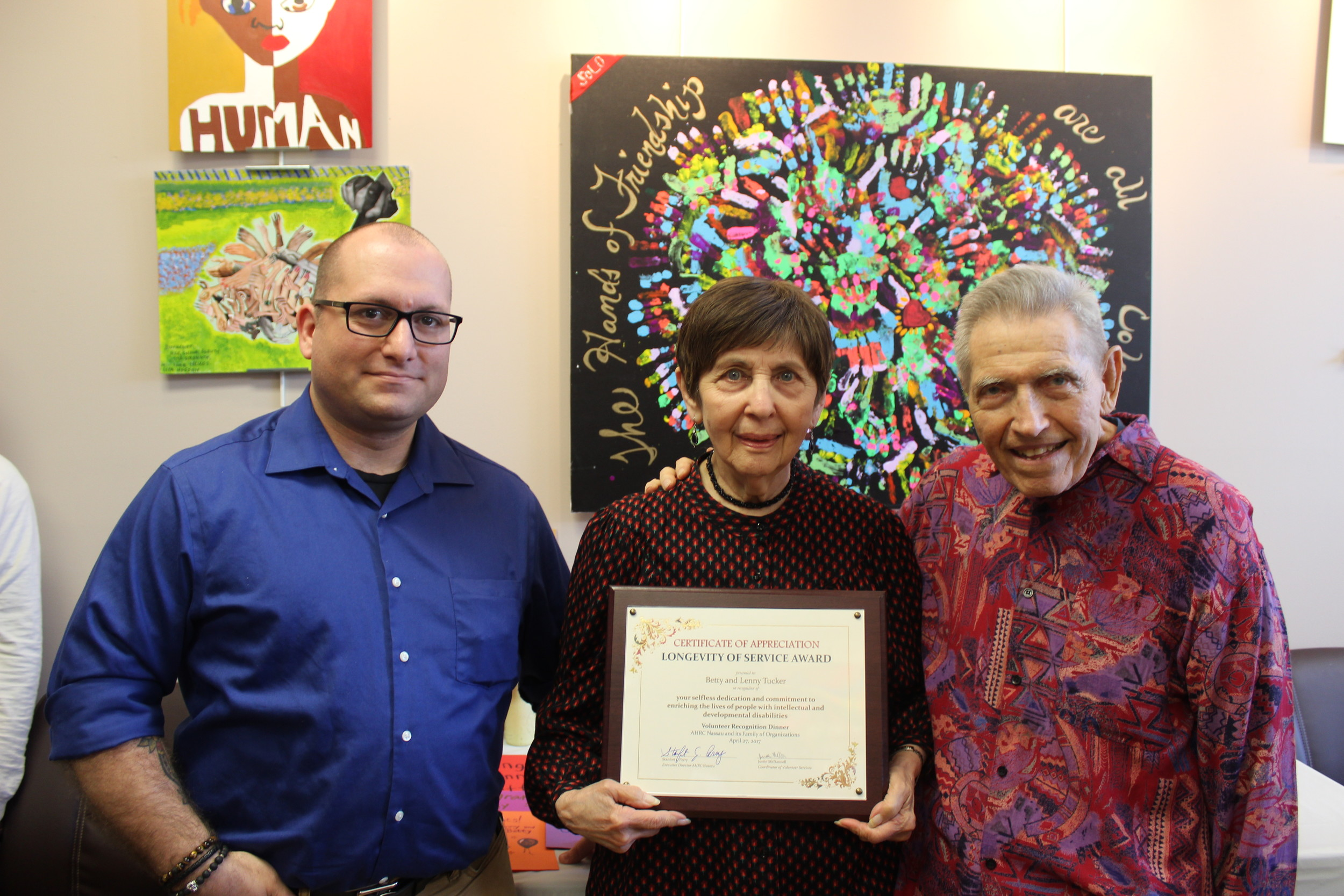 "Betty and Lenny Tucker recently received the ""Longevity Award"" for 21 years of volunteer service at the AHRC Nassau. Here they are joined with Justin McDannell, a volunteer and intern coordinator at AHRC Nassau, left."