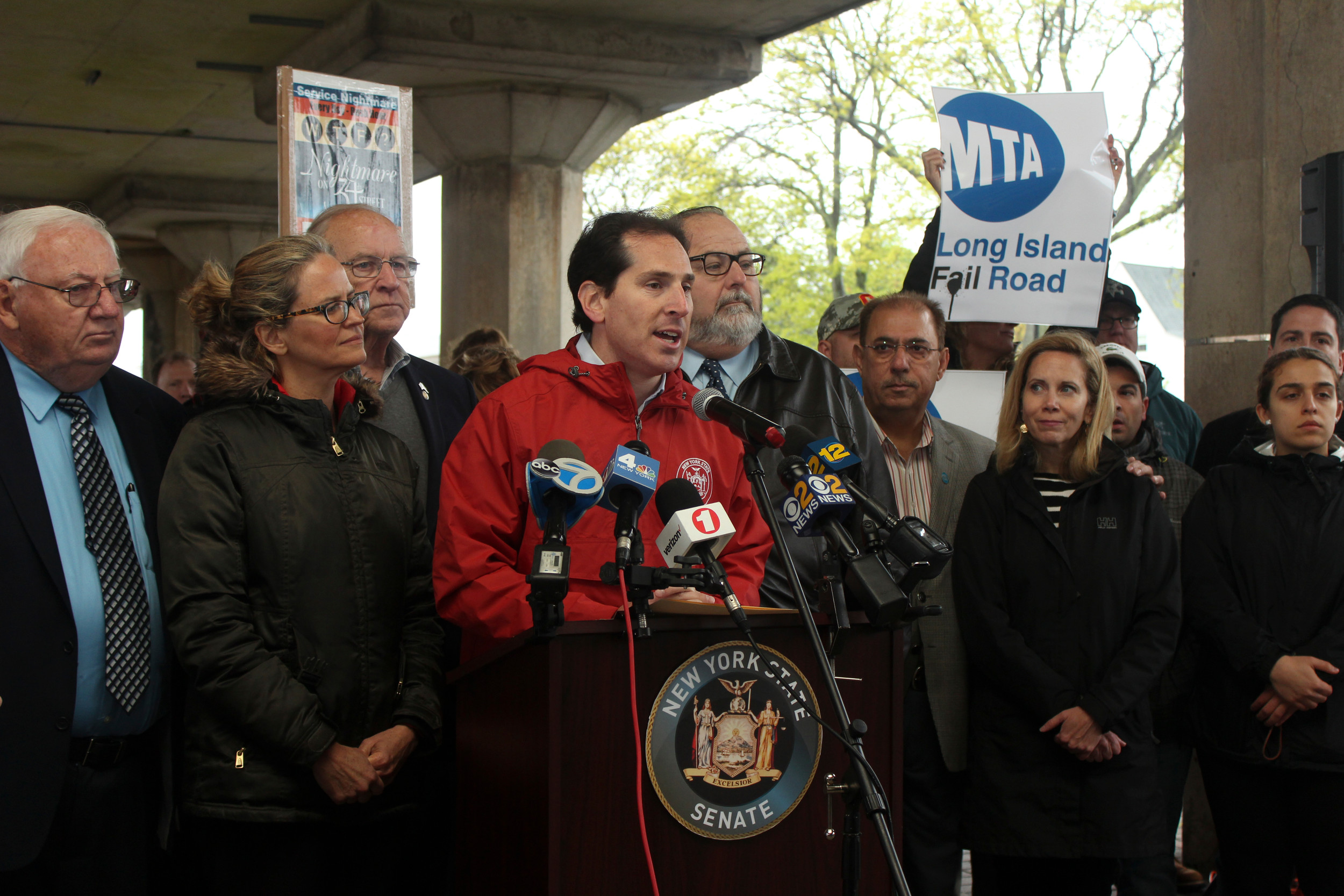 State Senator Todd Kaminsky, center, flanked by State Senator John Brooks, left, County Legislator Laura Curan, Assemblyman David McDonough, Rockville Centre Mayor Francis X. Murray and Laura Gillen, a Rockville Centre-based attorney currently running for Town of Hempstead supervisor. Kaminsky held the rally for the purpose of demanding the ouster of Amtrak as the owner of Pennsylvania Station.