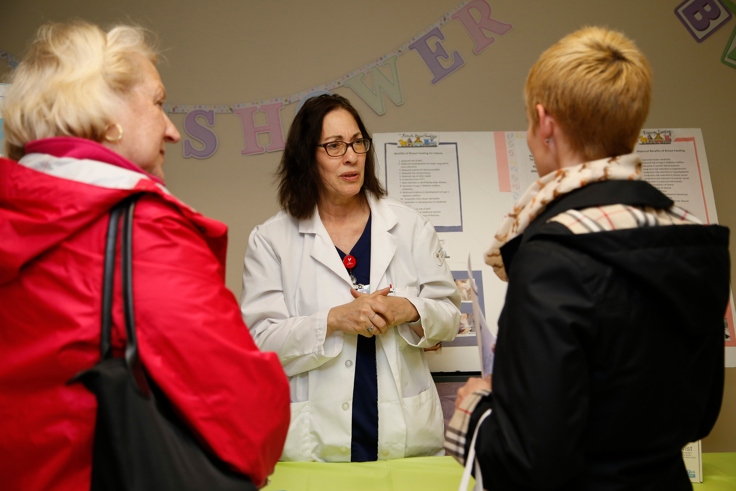 Mercy's Christine Foley, center, talks to Pam McLoughlin, left, and Anne Tepper about pre-natal classes.