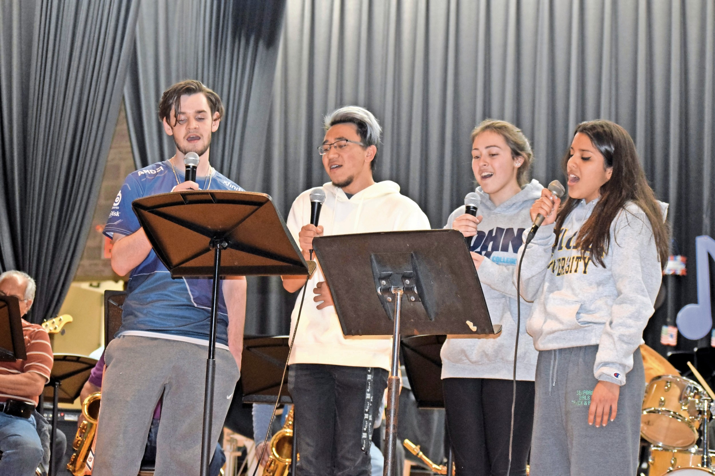 Seaford High School seniors sang in the chorus at the band's annual spring concert on May 13. Scott Wilson, left, Christopher Ho, Kayla Marino and Elissa Castro performed.