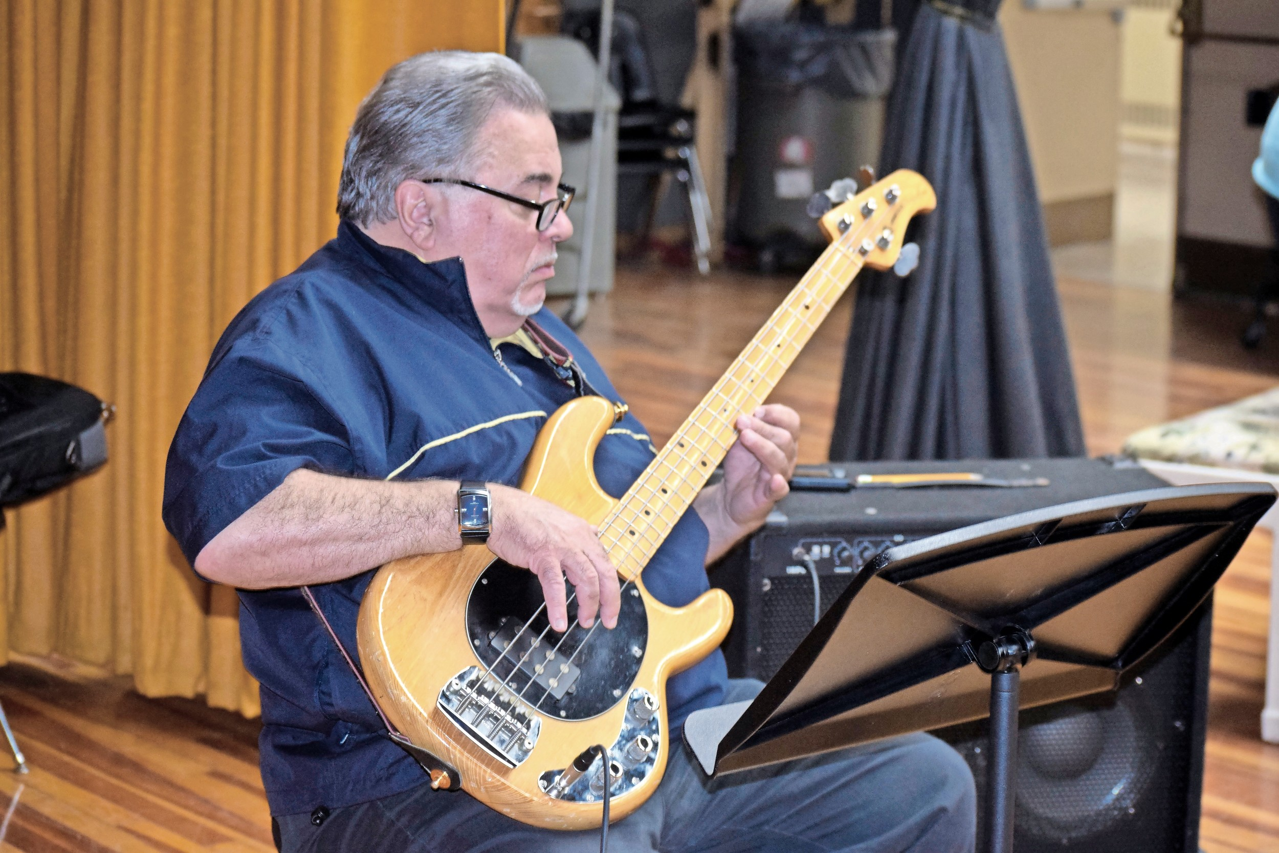 Cliff Heepe, a longtime member of the band, tuned his guitar for the spring concert.