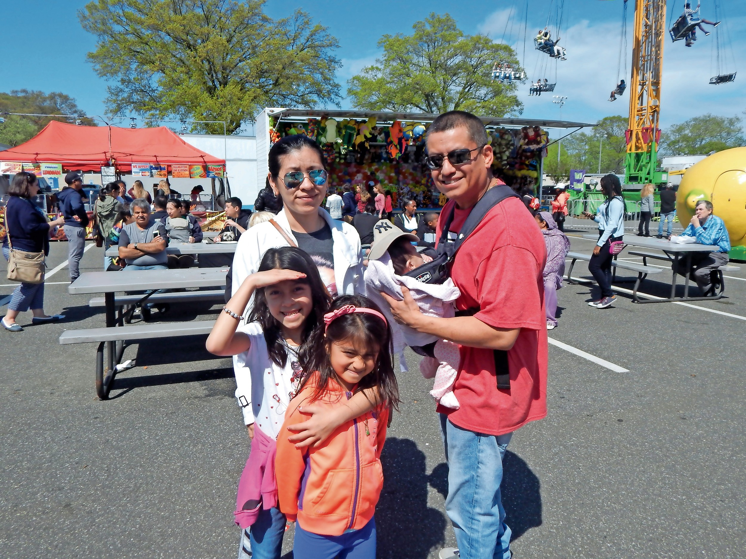 Emily and Alfredo Estrella brought their daughters Tiffany, Isabella, and Kaitlin to the carnival.