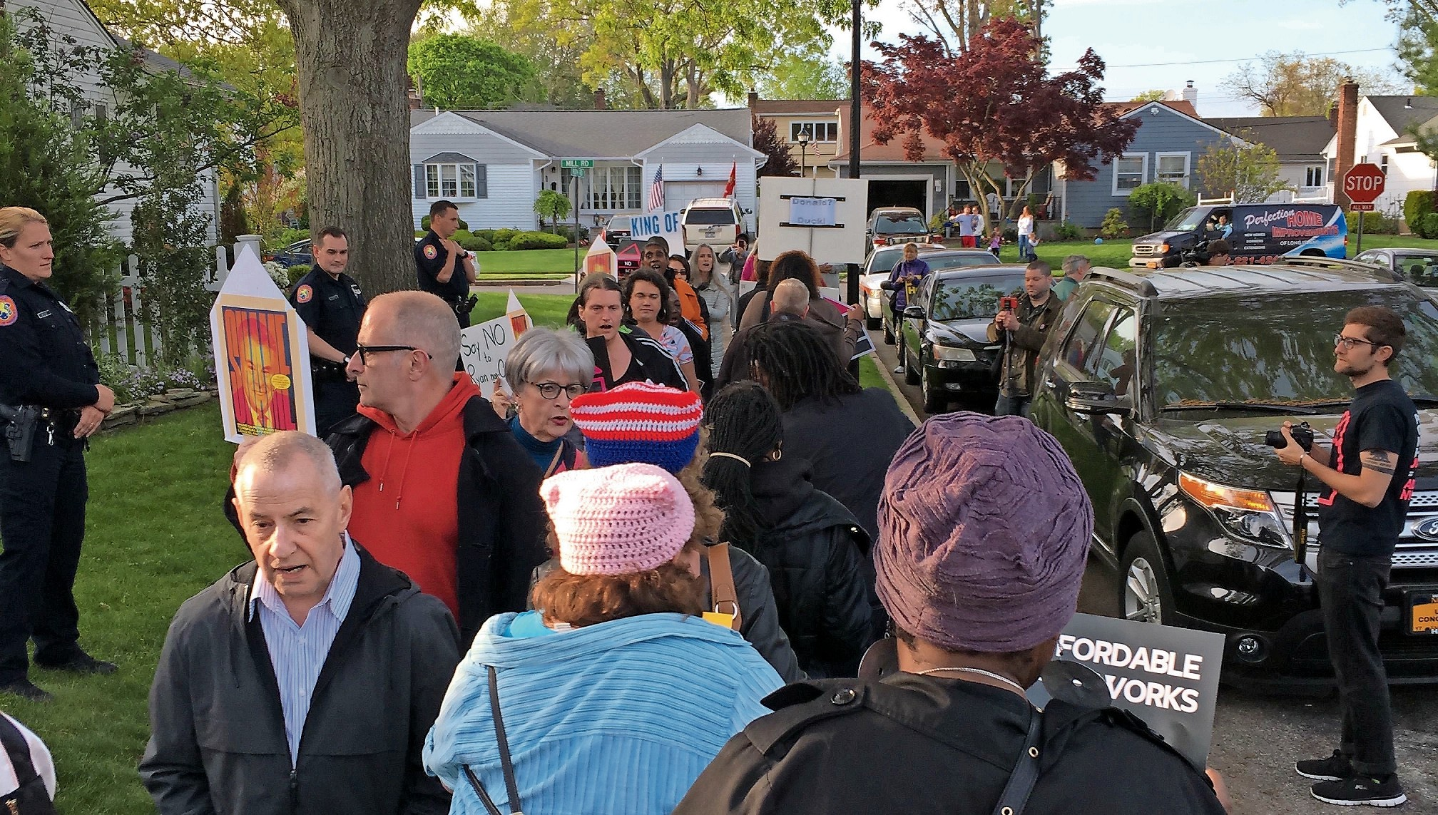 The demonstration was confined to the sidewalk on Roth Road, where King lives. The congressman was not home when protesters gathered outside his house.