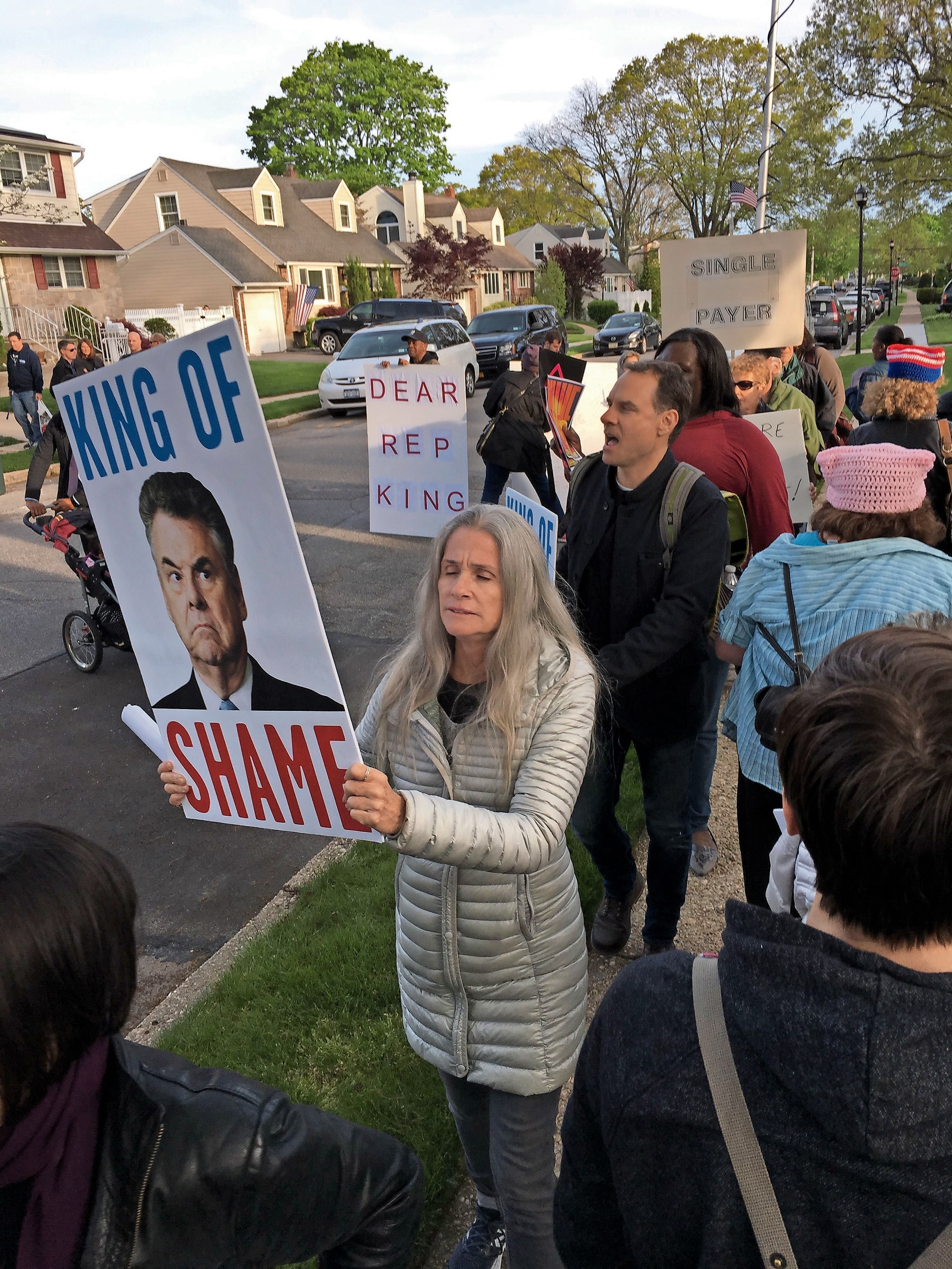 Long Island and New York City residents protested outside U.S. Rep. Peter King's home in Seaford on May 11.