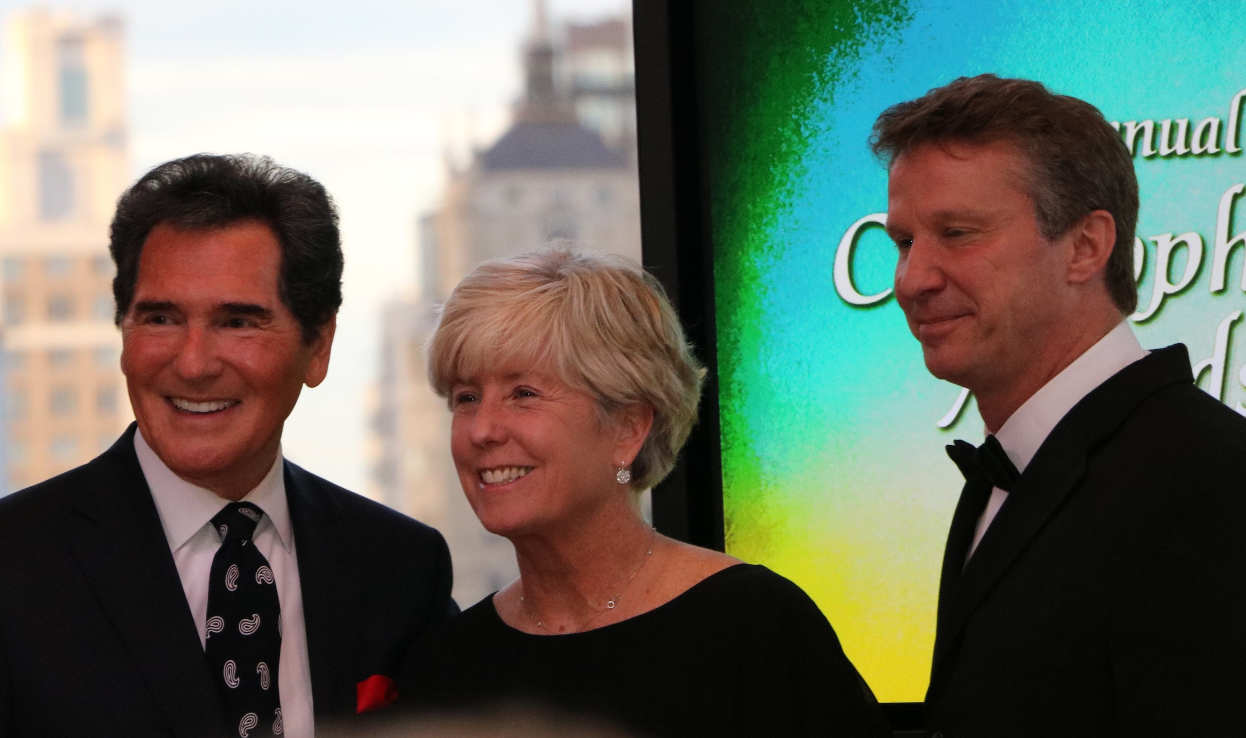 Malverne Mayor Patti Ann McDonald with Fox 5 anchor Ernie Anastos, left, and Dr. Chuck Dietzen at the Christopher Awards ceremony last week in Manhattan.