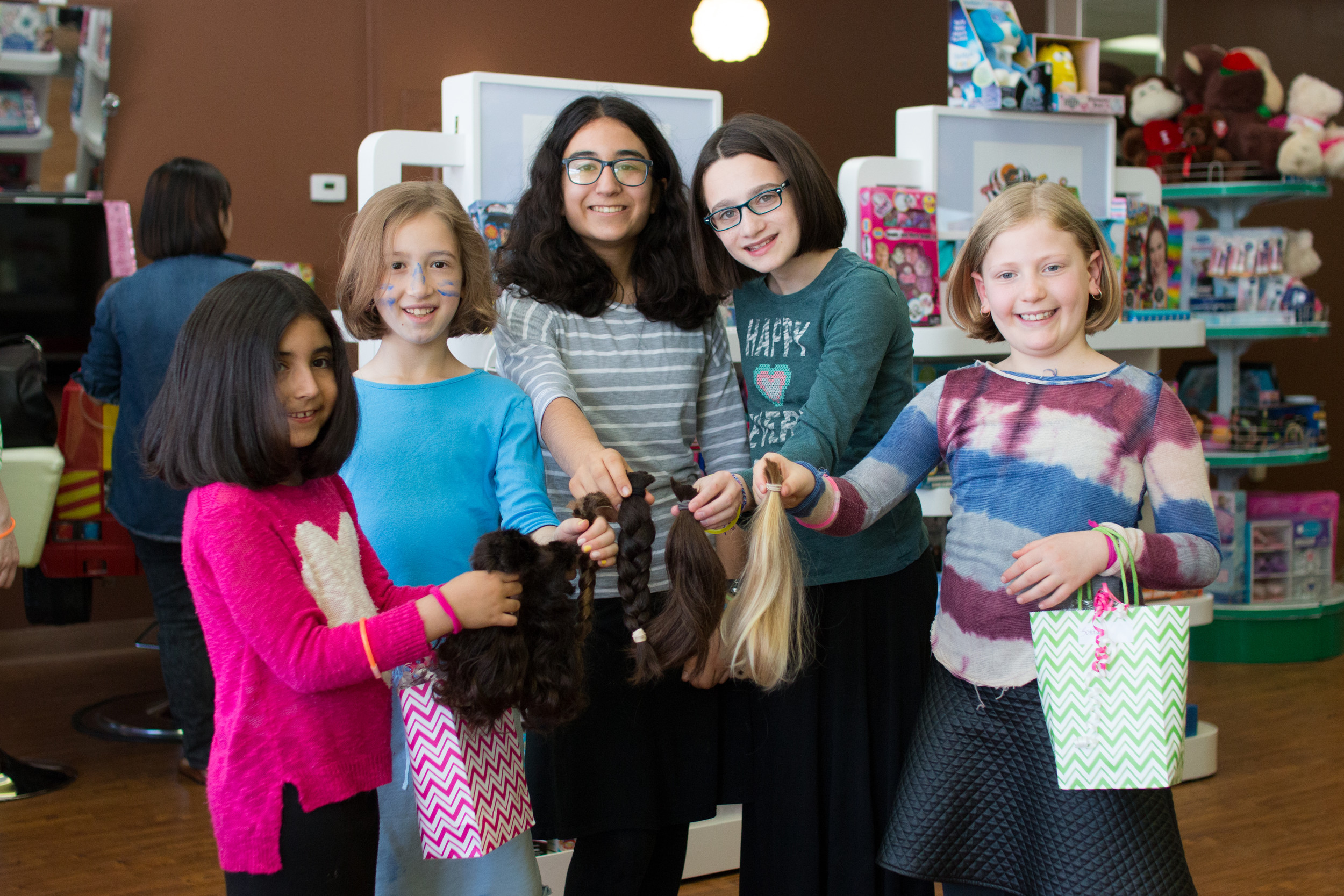 Students who donated hair to make wigs for children with cancer included, from left, Maya Goykadosh of Great Neck; Jasmine Nurieli of West Hempstead; Hannah Goykadosh of Greak Neck; Neira Rosenbaum of West Hempstead; and Sonia Kaynan of Jamaica Estates.