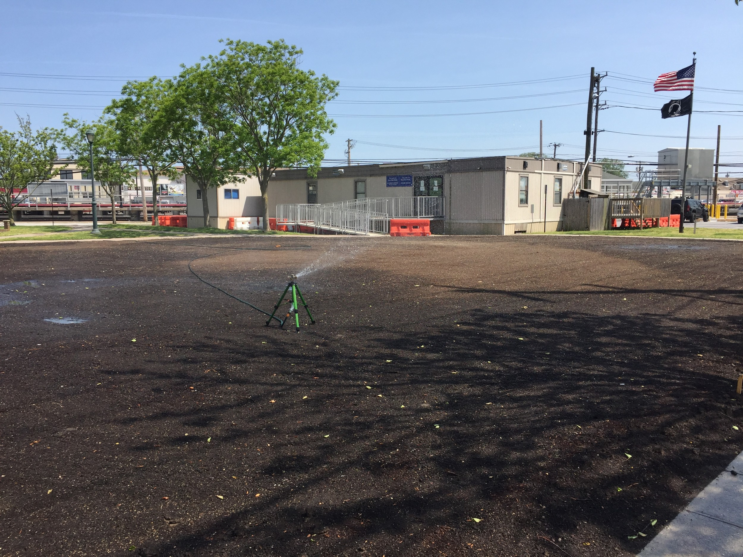 The village has started planting grass on the old Village Hall property, which will become a park and, officials hope, enhance the appeal of Long Beach Road.