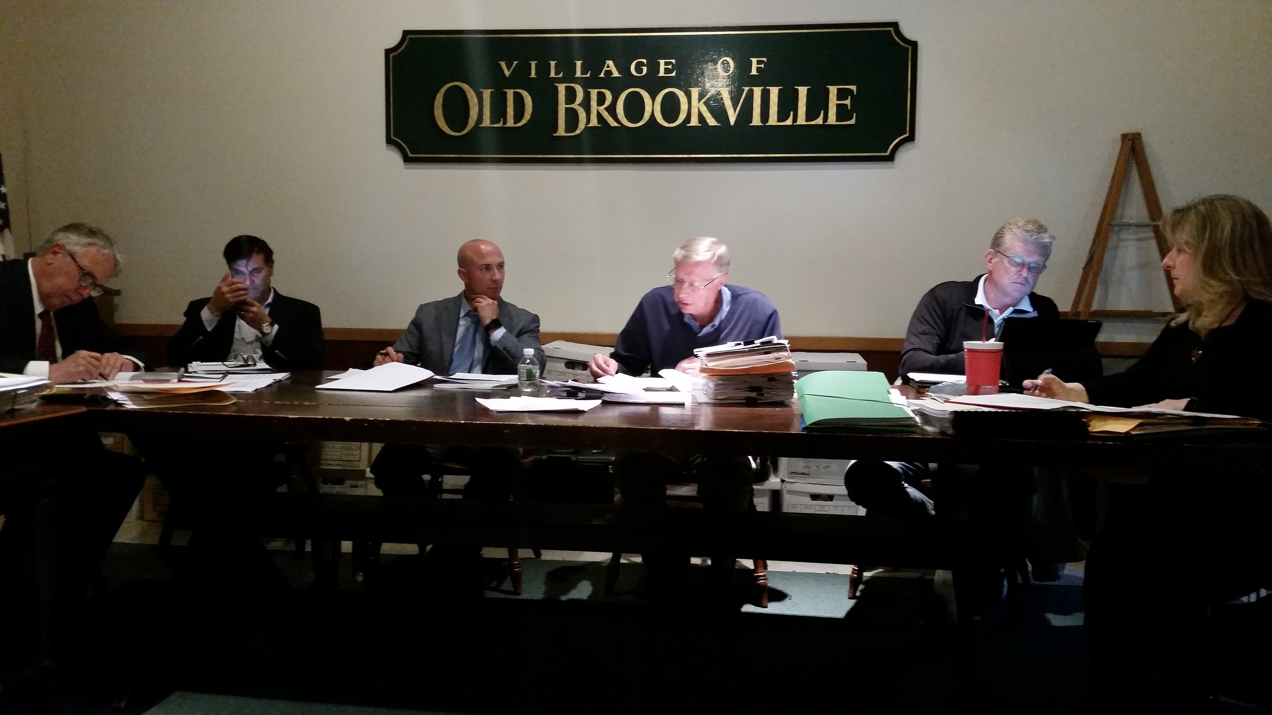 The Old Brookville Board of Trustees addressed several questions about the property on Route 25A where there's now an old gas station.